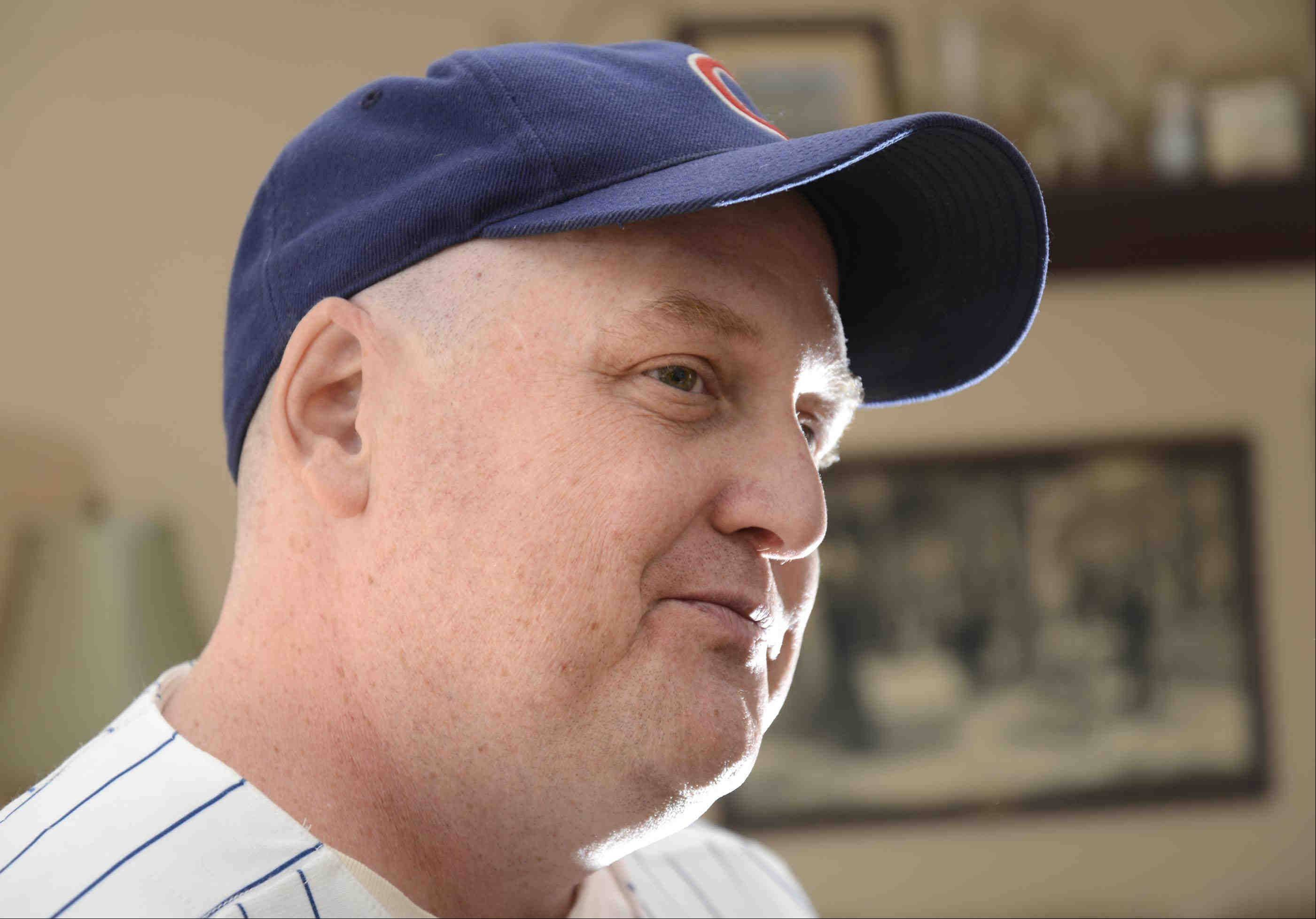 "Losing his favorite Cubs hat, only to see it miraculously show up nine months later after surviving a hurricane, is proof that ""hope springs eternal,"" says Charley McLenna in his Lake in the Hills home."