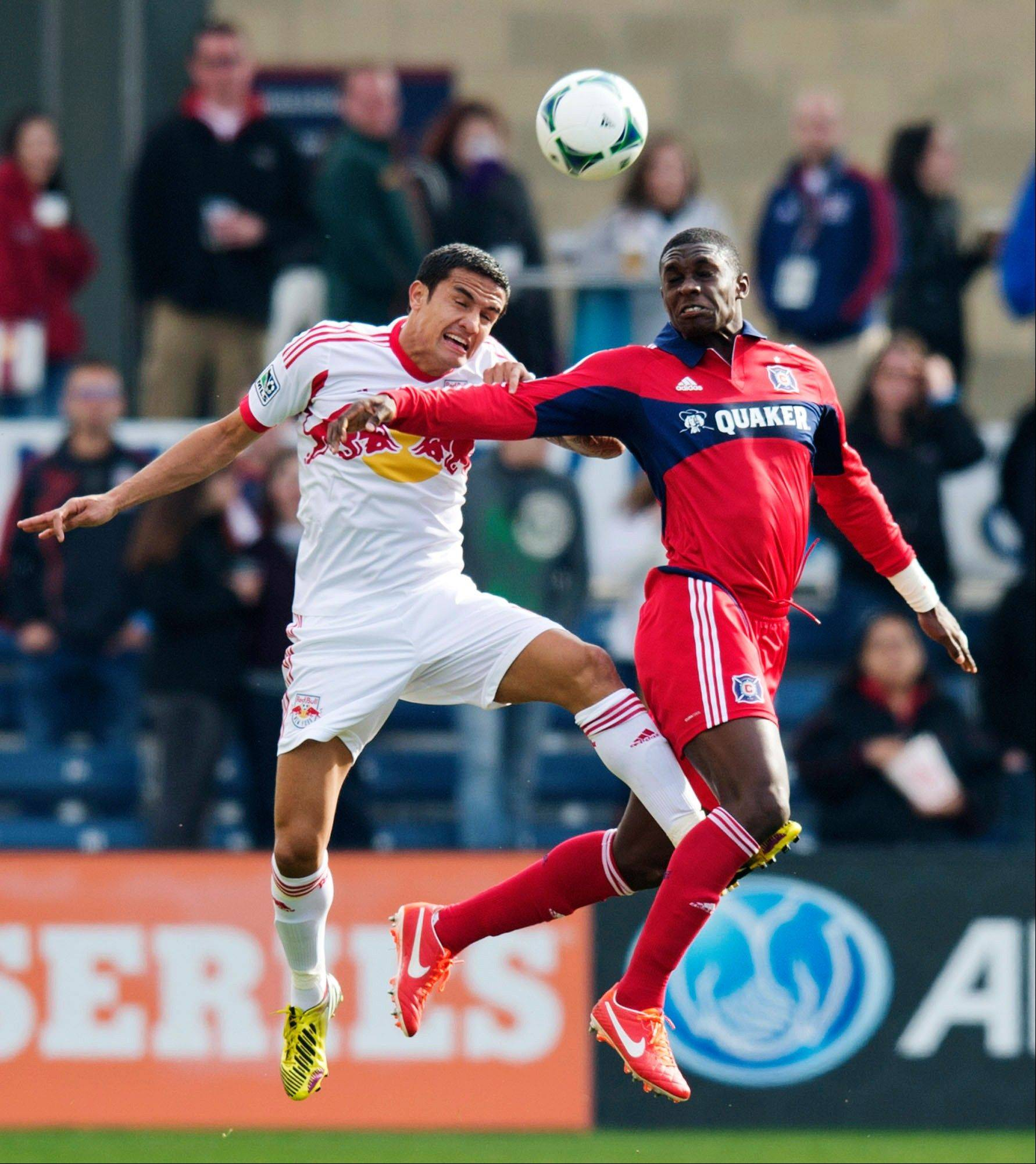 In this photo provided by the Chicago Fire, New York Red Bulls forward Tim Cahill, left, and Chicago Fire defender Jalil Anibaba go for the ball during the first half of an MLS soccer match, Sunday, April 7, 2013, in Bridgeview, Ill. The Fire won 3-1.