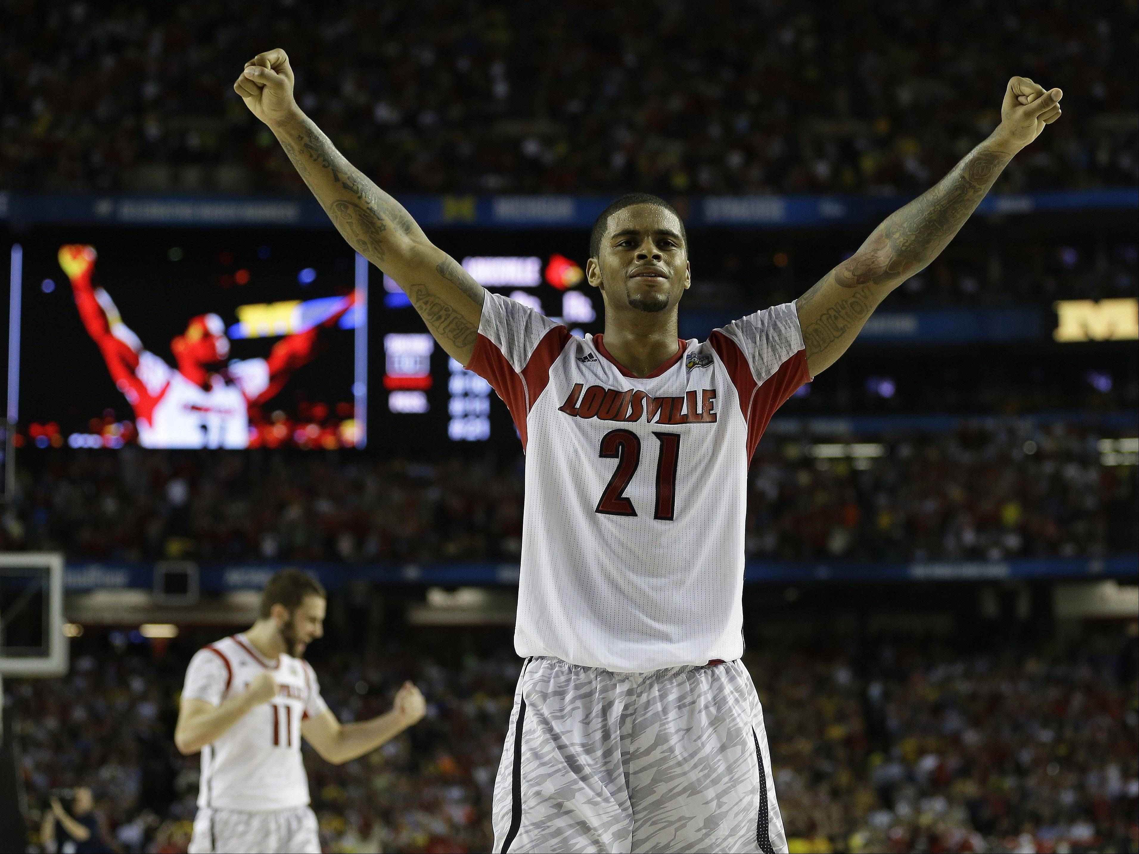 Louisville forward Chane Behanan (21) reacts after defeating Michigan after the second half of the NCAA Final Four tournament college basketball championship game Monday, April 8, 2013, in Atlanta. Louisville won 82-76.