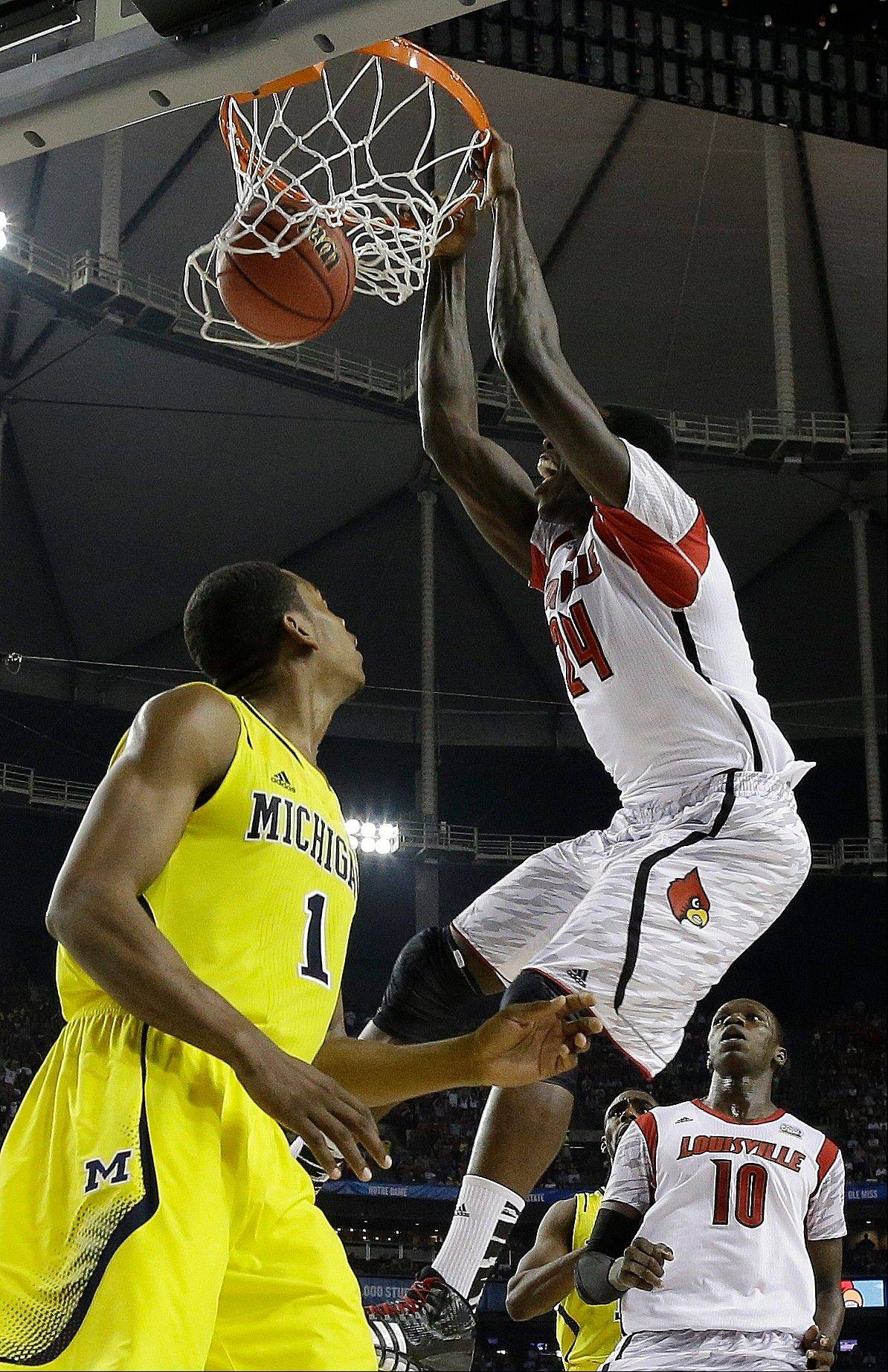 Louisville forward Montrezl Harrell (24) dunks the ball against Michigan forward Glenn Robinson III (1) during the first half of the NCAA Final Four tournament college basketball championship game Monday, April 8, 2013, in Atlanta.
