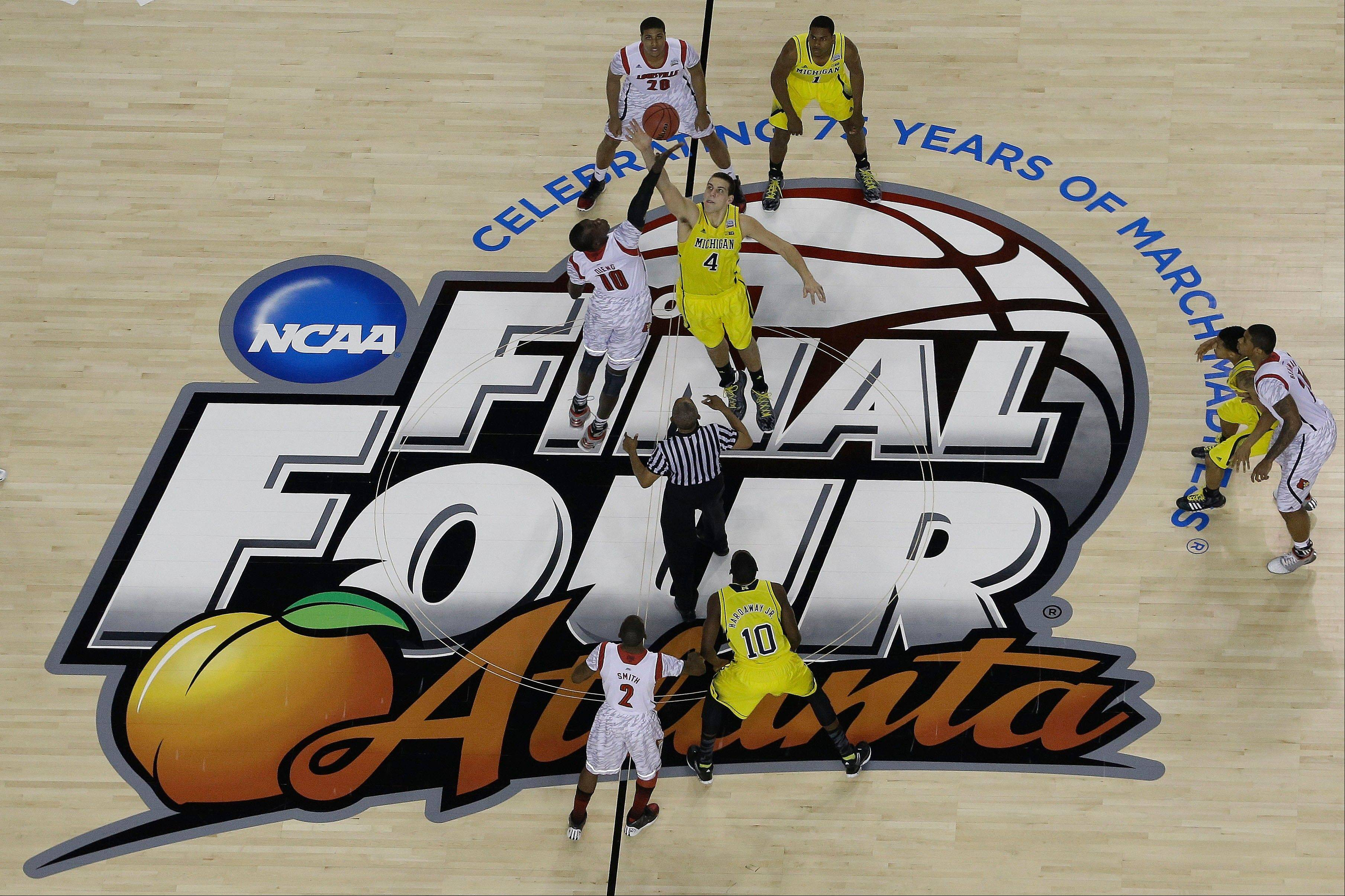 Michigan and Louisville play during the first half of the NCAA Final Four tournament college basketball championship game Monday, April 8, 2013, in Atlanta.