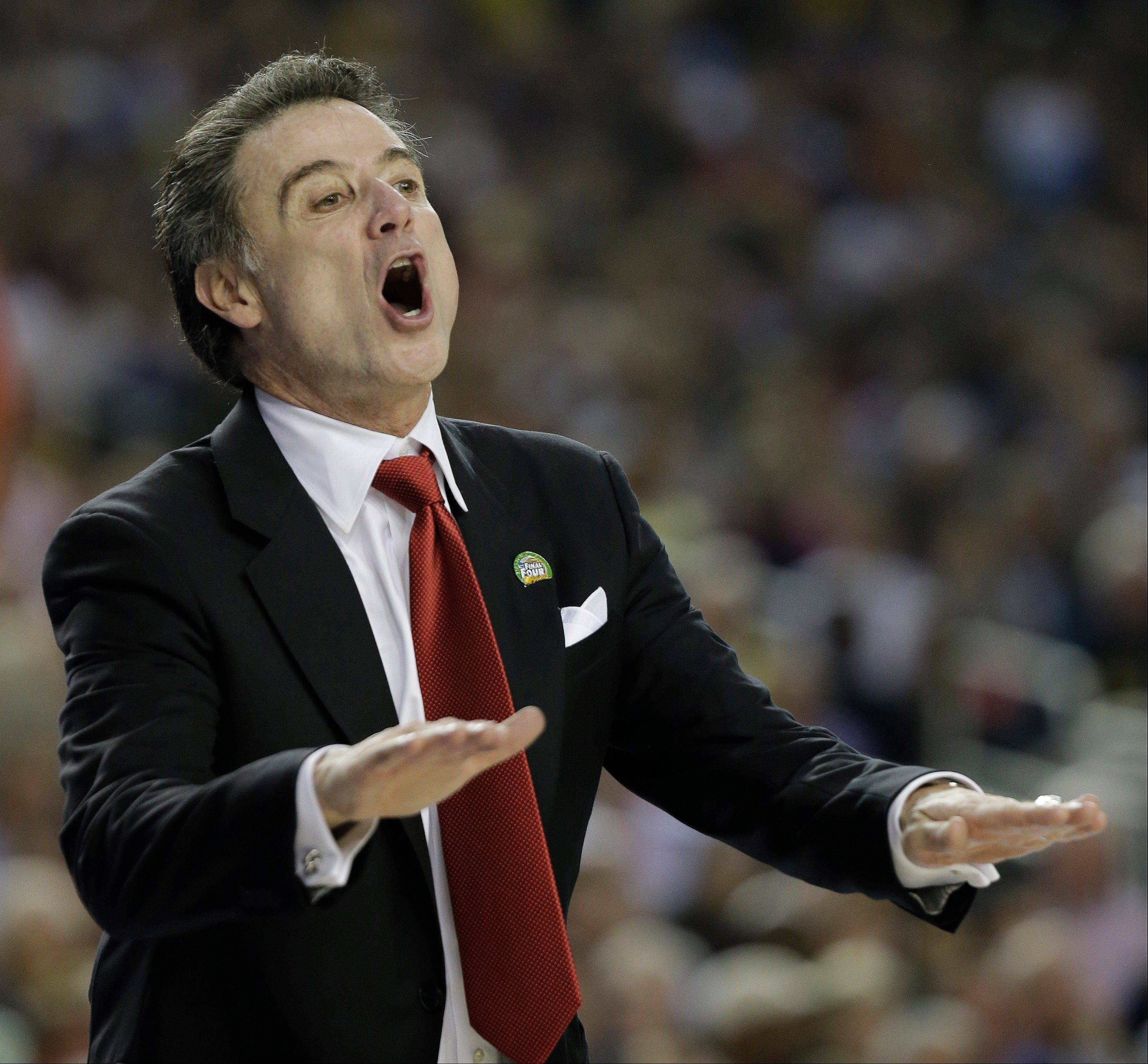Louisville head coach Rick Pitino reacts to play against the Michigan during the first half of the NCAA Final Four tournament college basketball championship game Monday, April 8, 2013, in Atlanta.