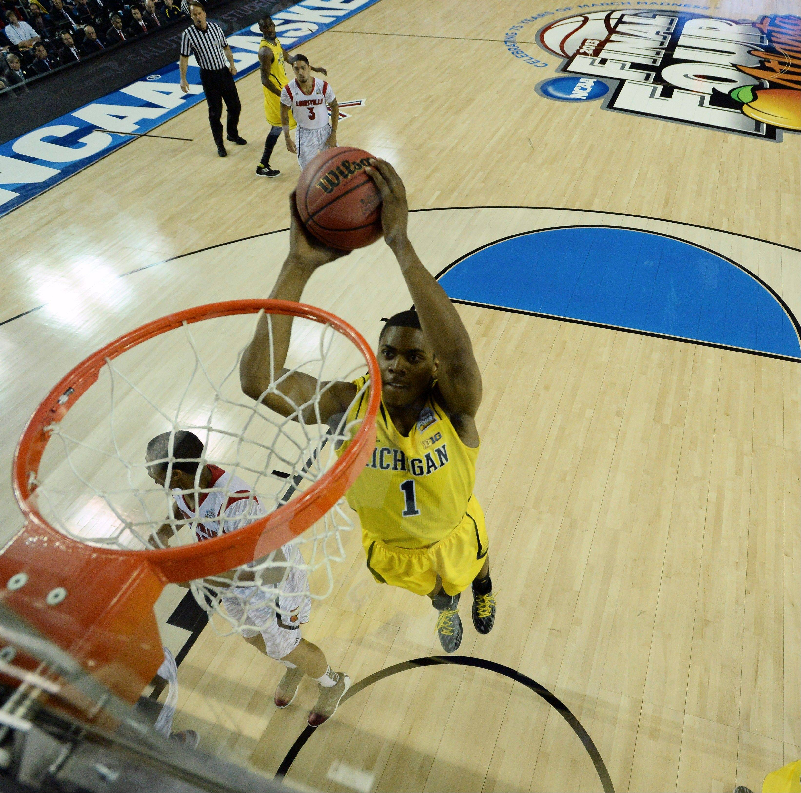 Michigan forward Glenn Robinson III (1) dunks the ball against the Louisville during the second half of the NCAA Final Four tournament college basketball championship game Monday, April 8, 2013, in Atlanta.