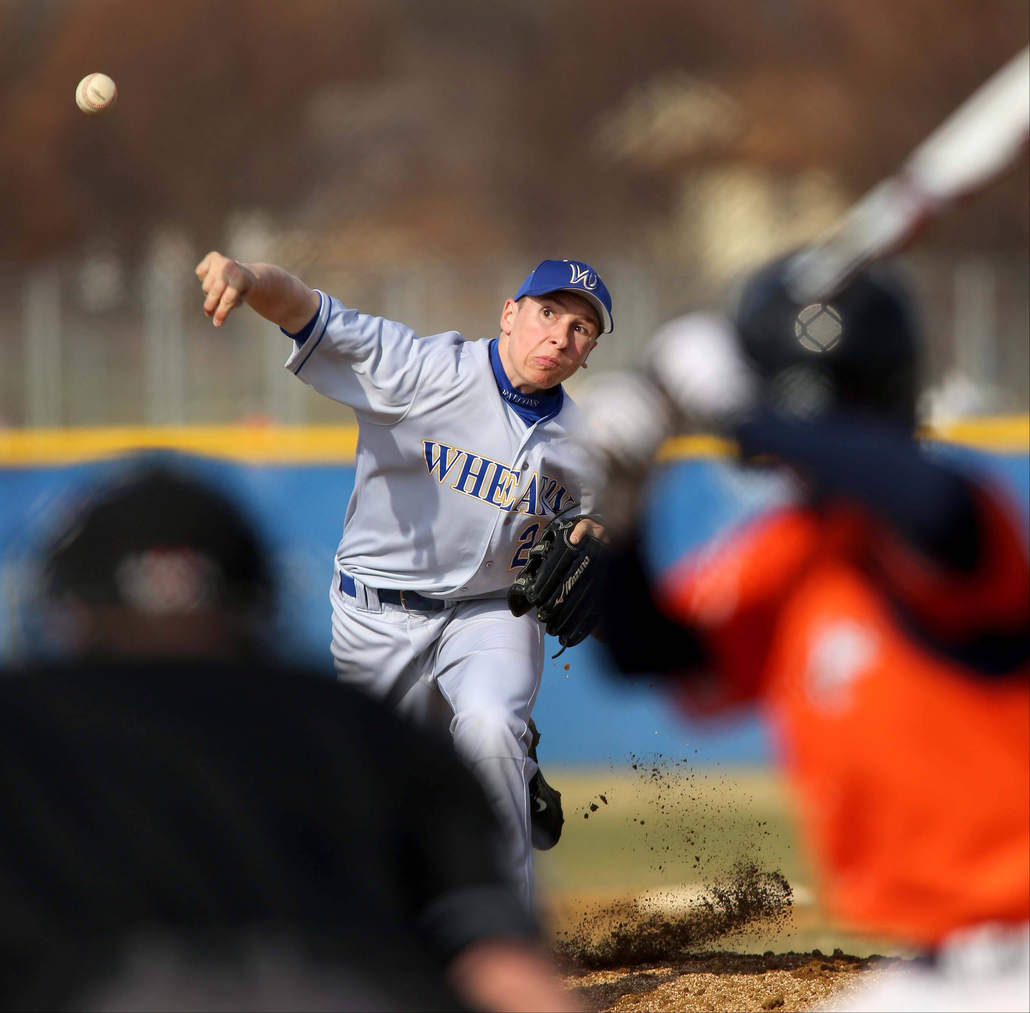 Lake Bachar of Wheaton North pitches against Naperville North during baseball on Monday in Naperville.
