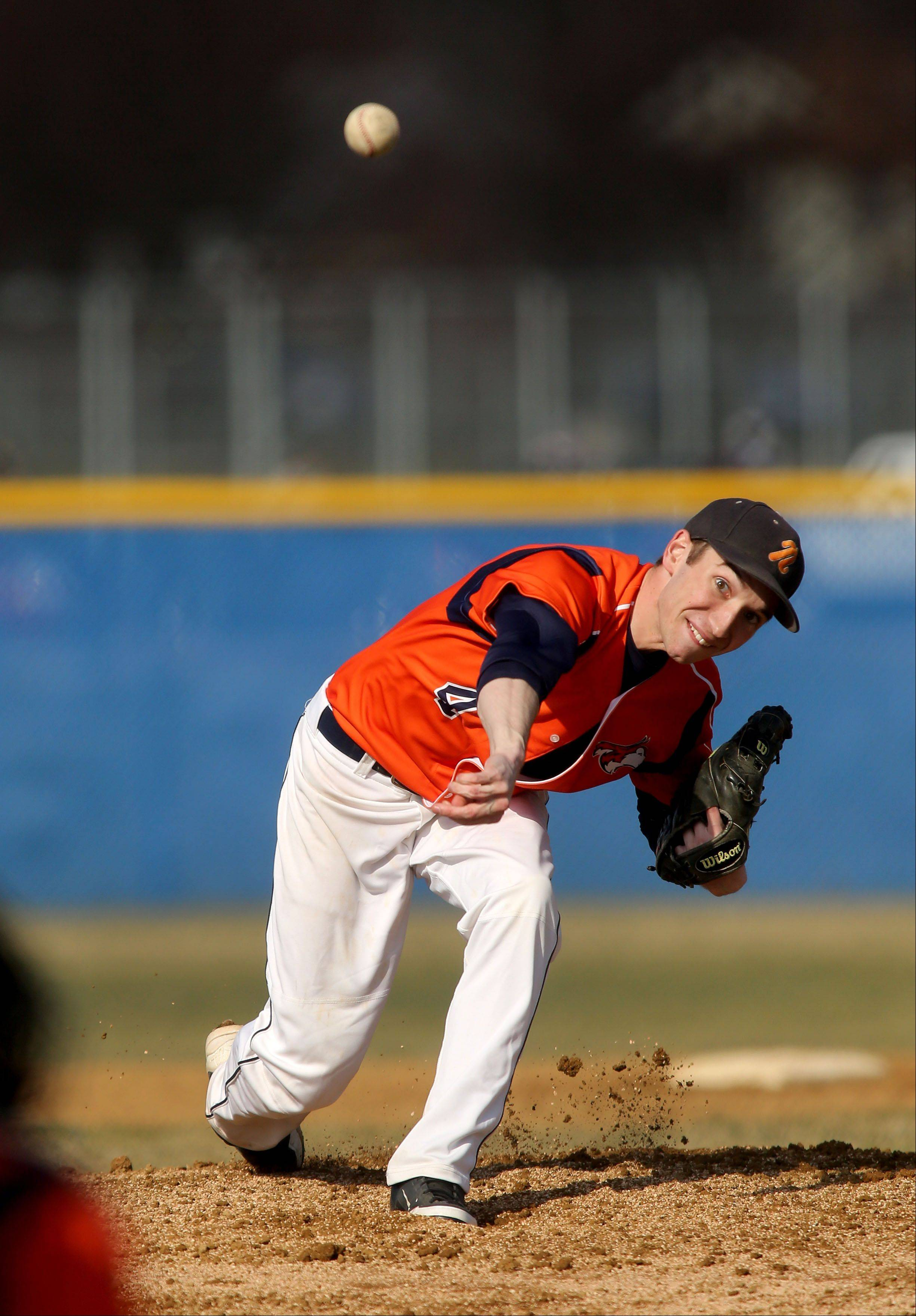 Colin Ash of Naperville North is on the mound against Wheaton North during baseball on Monday in Naperville.