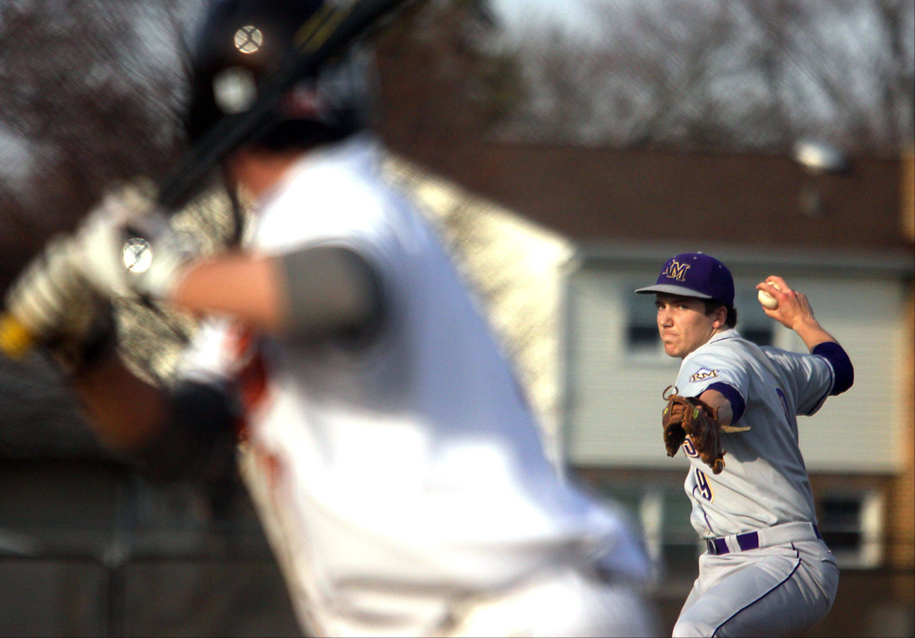 Rolling Meadows starter Matt Dennis delivers at Hersey on Monday.
