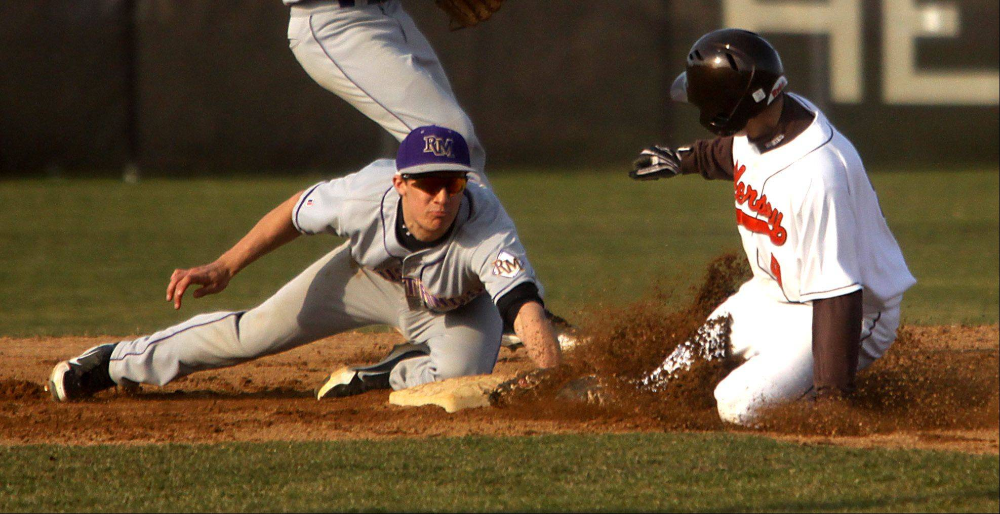 Rolling Meadows' Zach Schultz, left, tags out Hersey's Jake Yager on an attempted steal of second base at Hersey on Monday.