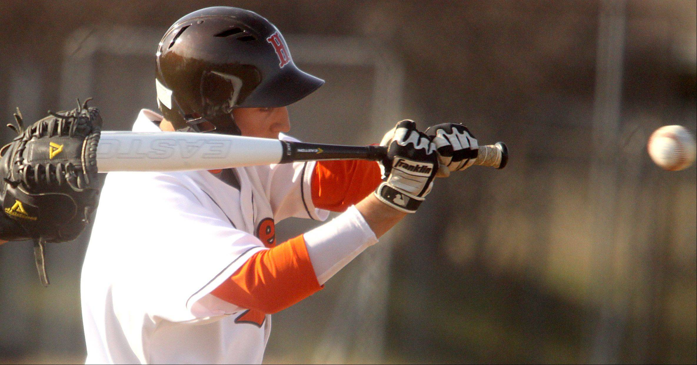 Hersey's Andrew Segalla takes a cut against Rolling Meadows at Hersey on Monday.