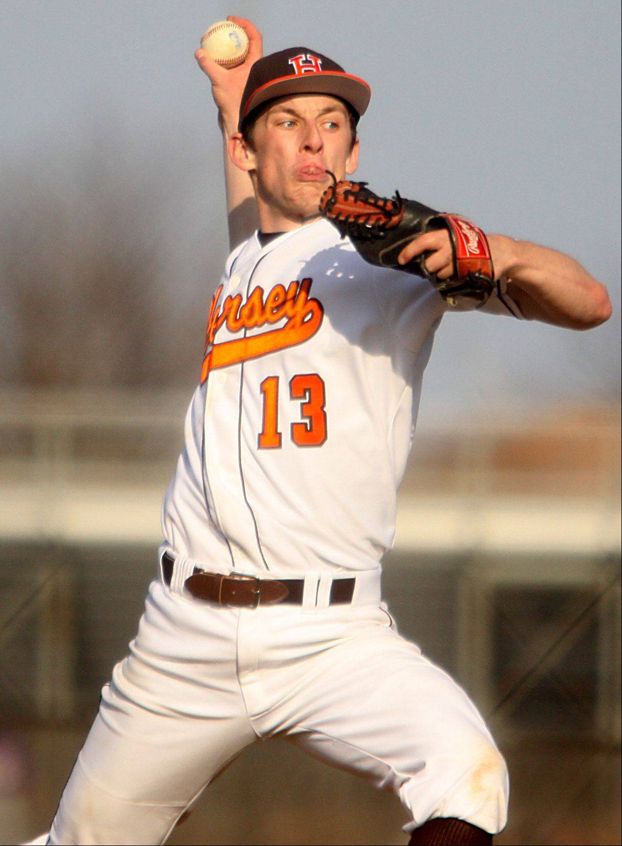 Hersey pitcher Alex Sutrinaitis makes an offering to Rolling Meadows at Hersey on Monday.
