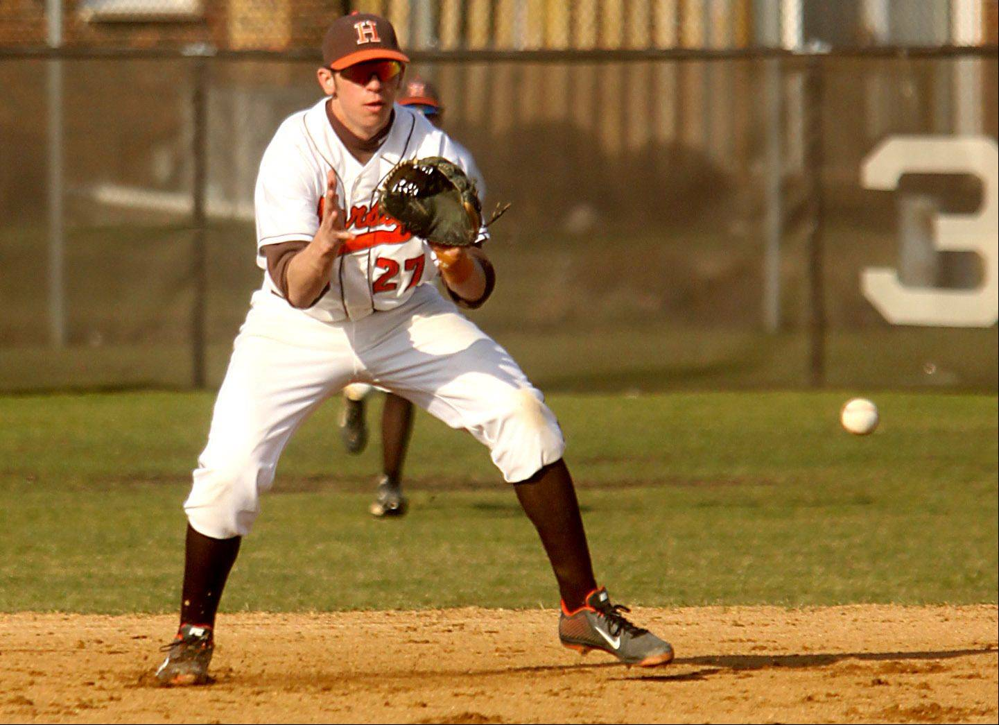 Hersey's David Milligan takes a grounder against Rolling Meadows at Hersey on Monday night.