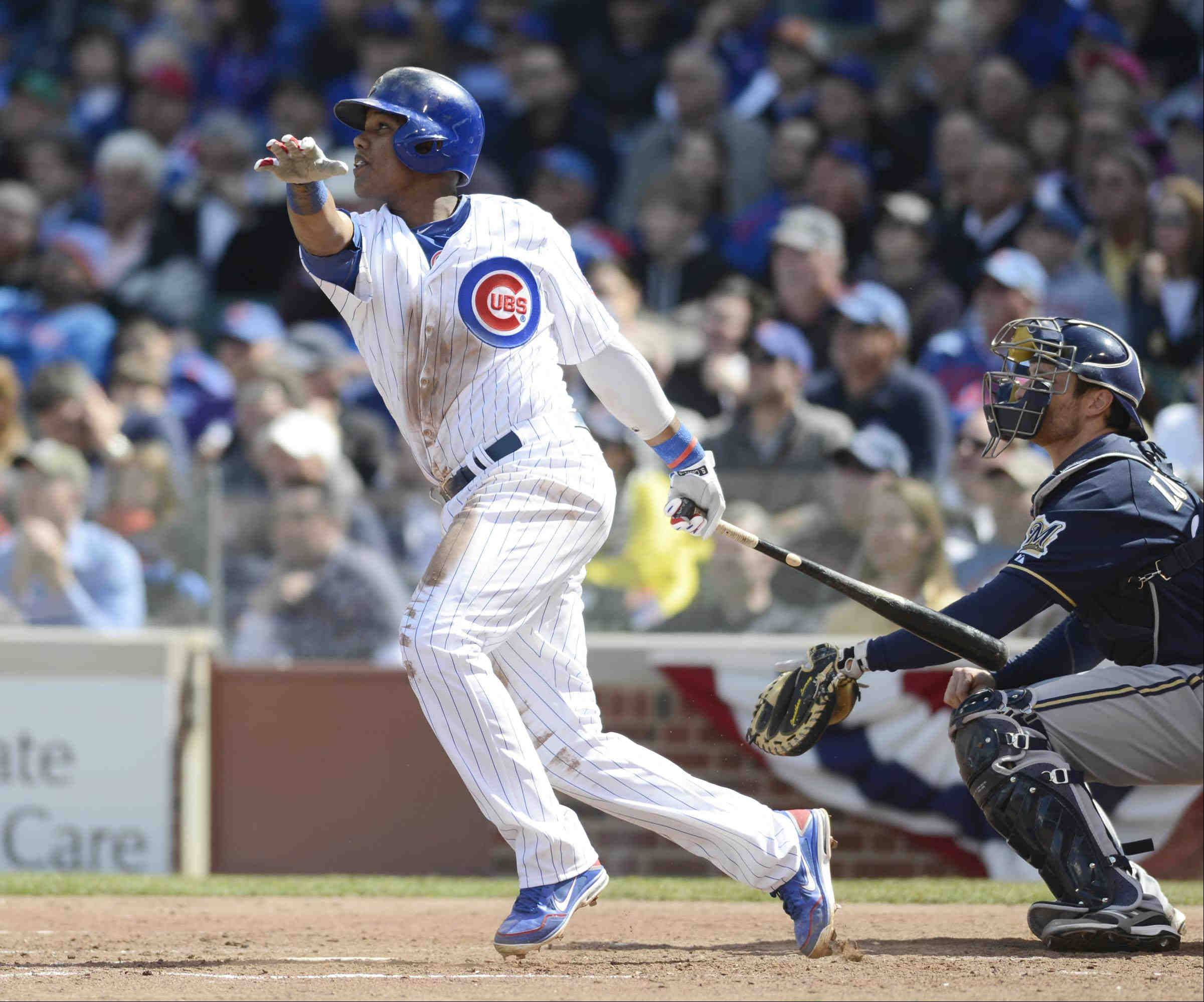 Cubs shortstop Starlin Castro hits a triple with two outs in the third inning against the Brewers at Wrigley Field on Monday.