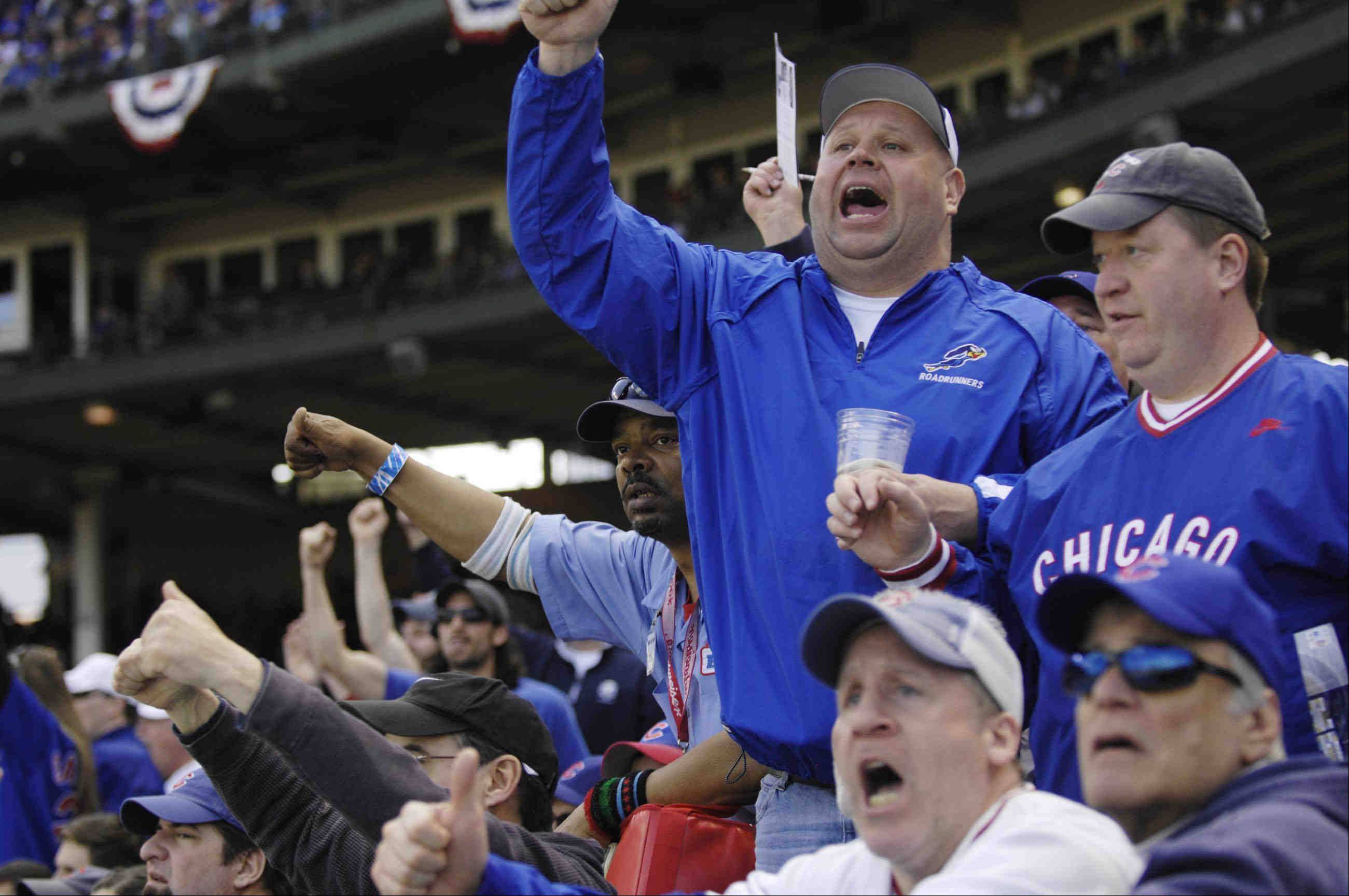 Fans yell at the third base umpire Monday during the Cubs' home-opener.