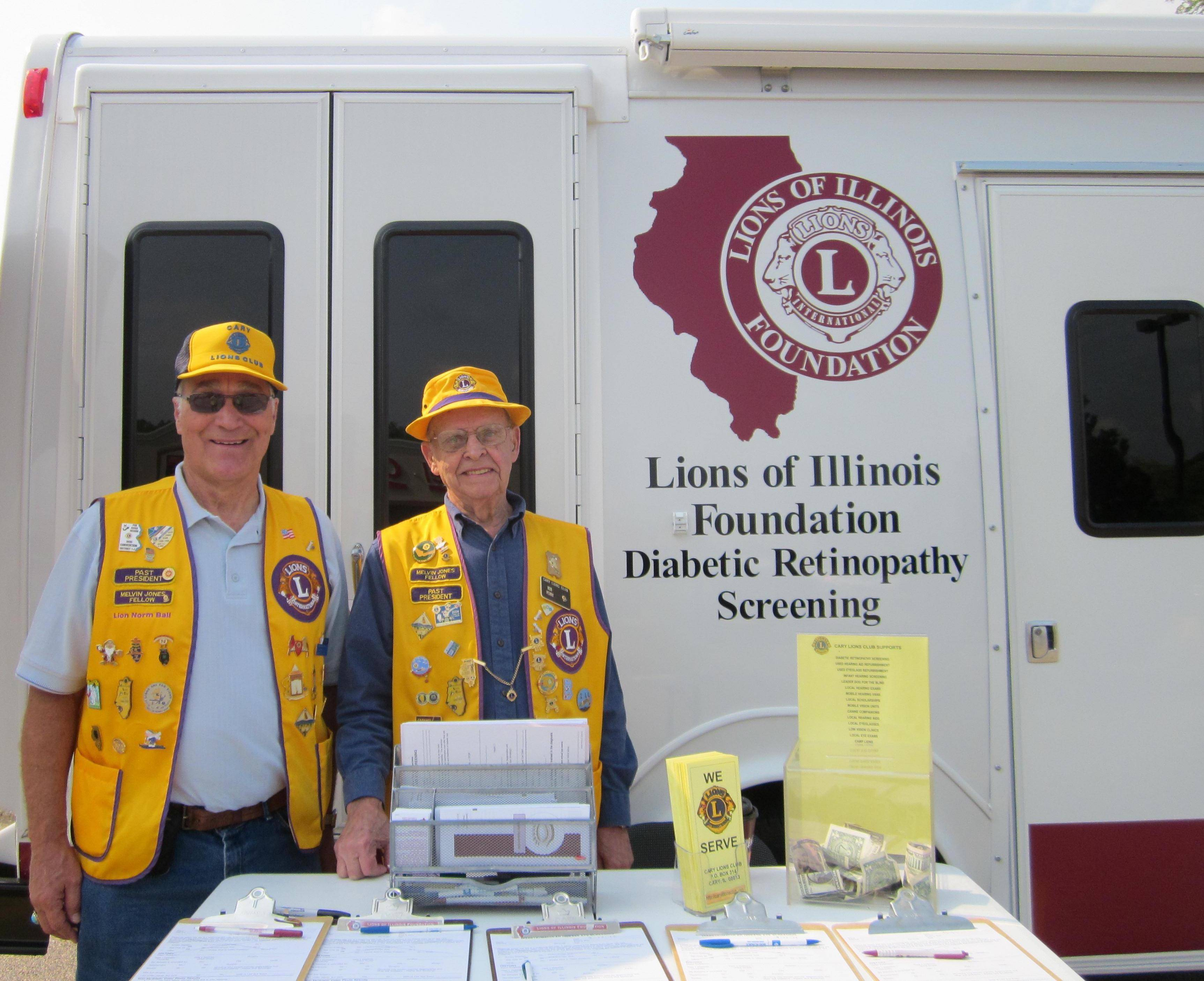 Cary Lions Norm Ball (l) and Bob Perry are ready to assist guests to obtain FREE hearing & vision screenings