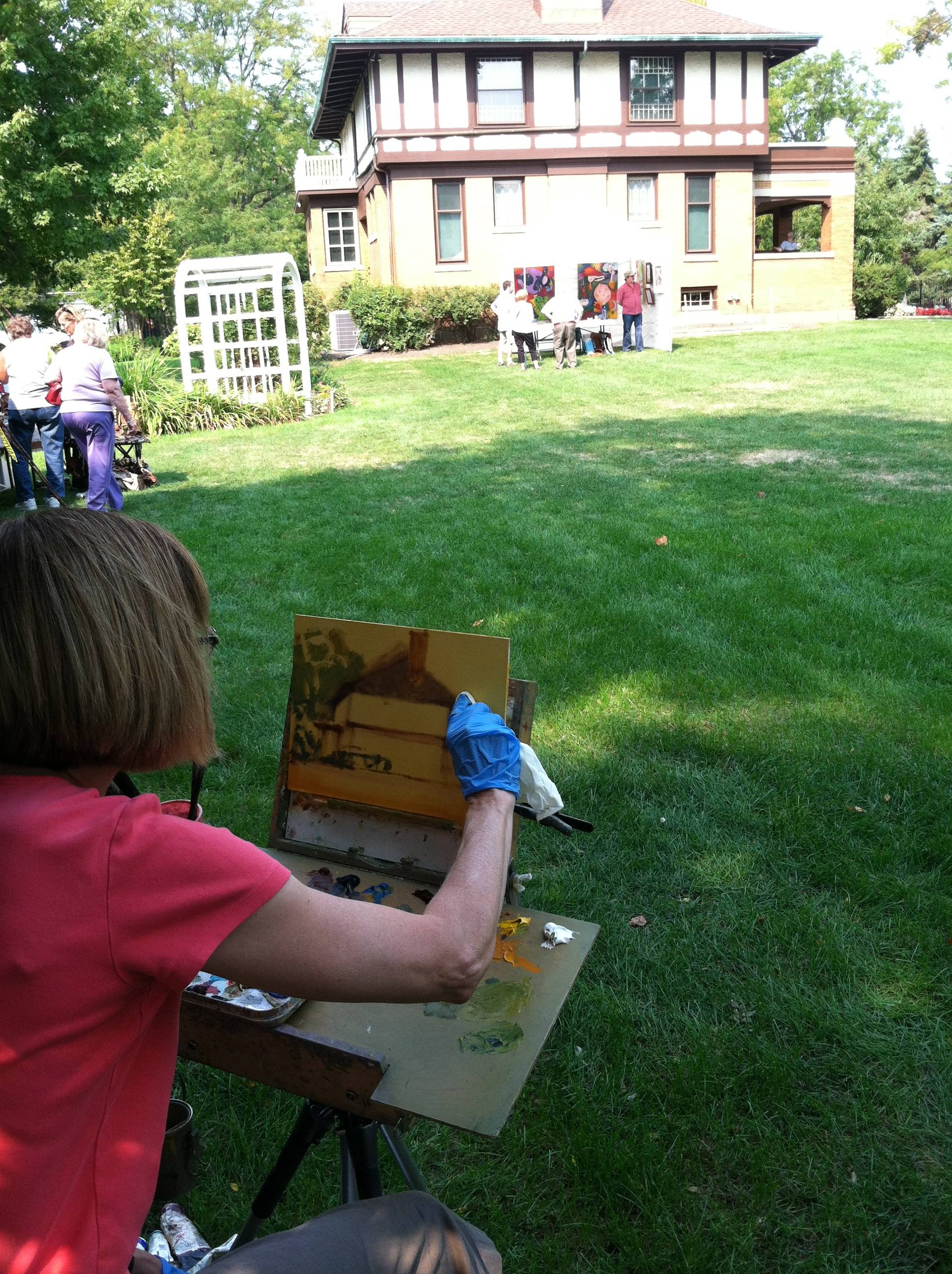 Artist Anne Kauff creates a plein air painting of the Banta House during an event at the Museum last year.