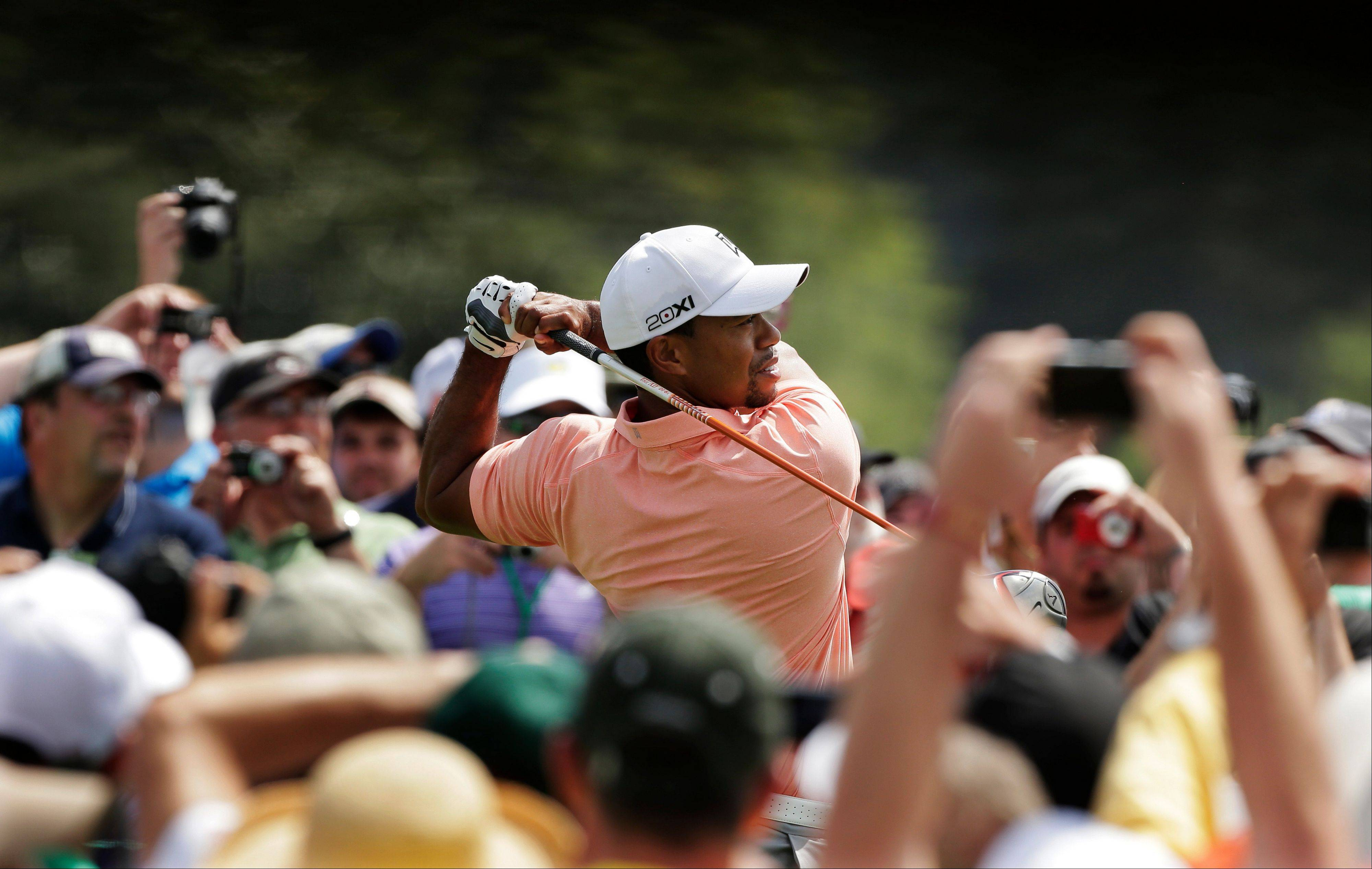 Tiger Woods tees off on the first hole during a practice round for the Masters golf tournament Tuesday in Augusta, Ga.
