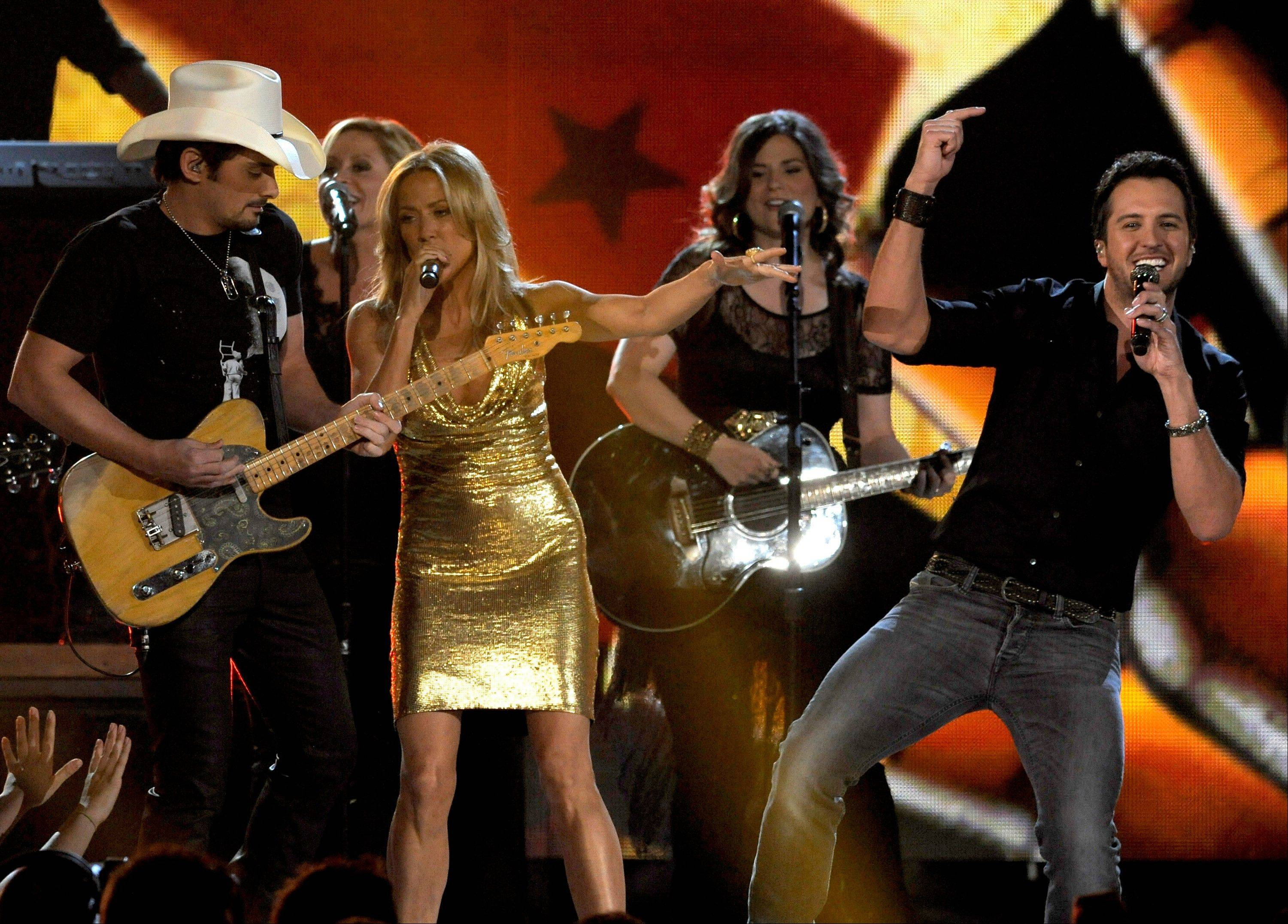 Brad Paisley, left, Cheryl Crow and Luke Bryan perform onstage at the 48th Annual Academy of Country Music Awards in Las Vegas on Sunday.
