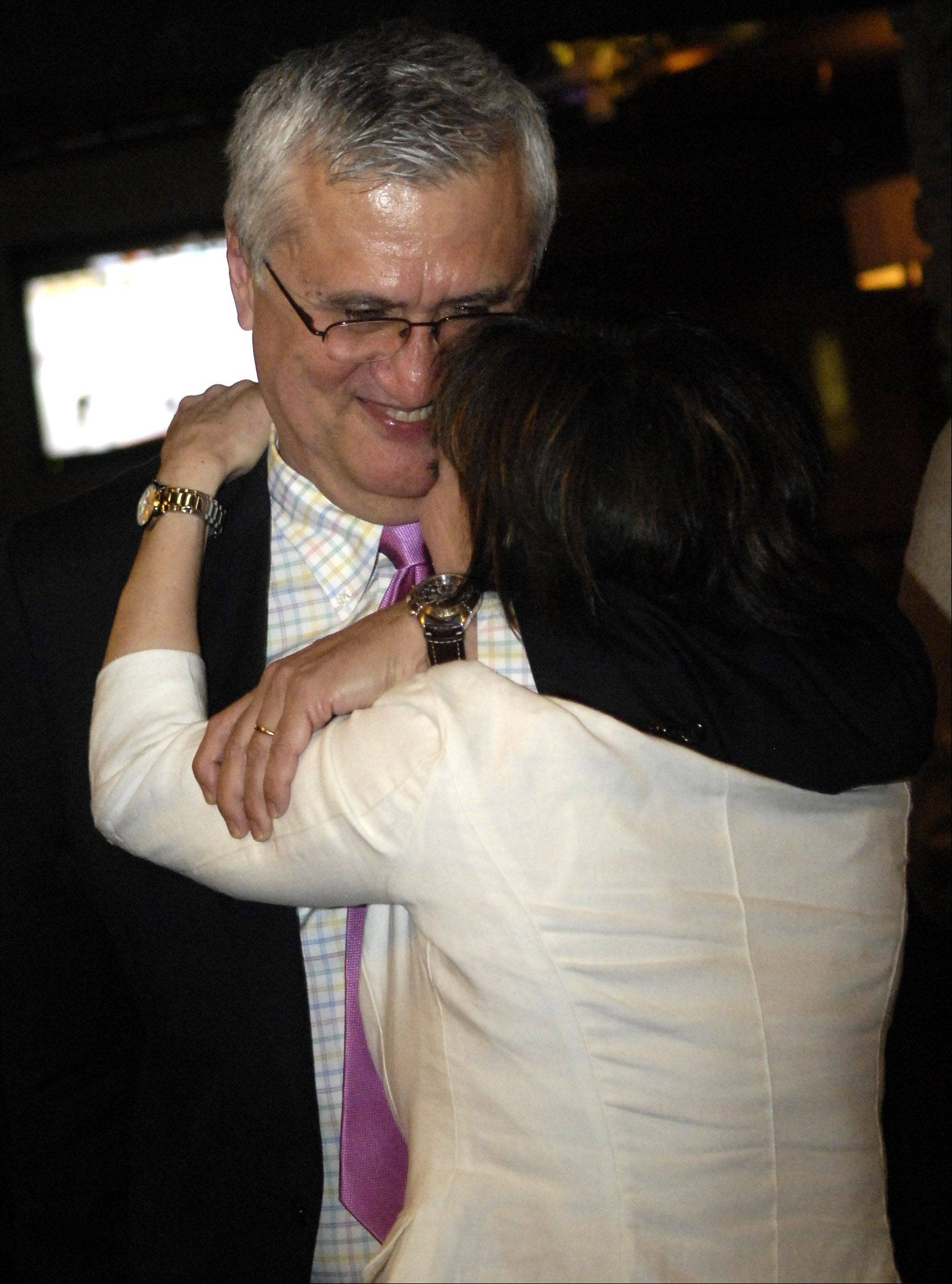 Ray Rogina gets a hug from his wife, Diane Cullen, after learning that he won his race for mayor of St. Charles Tuesday.