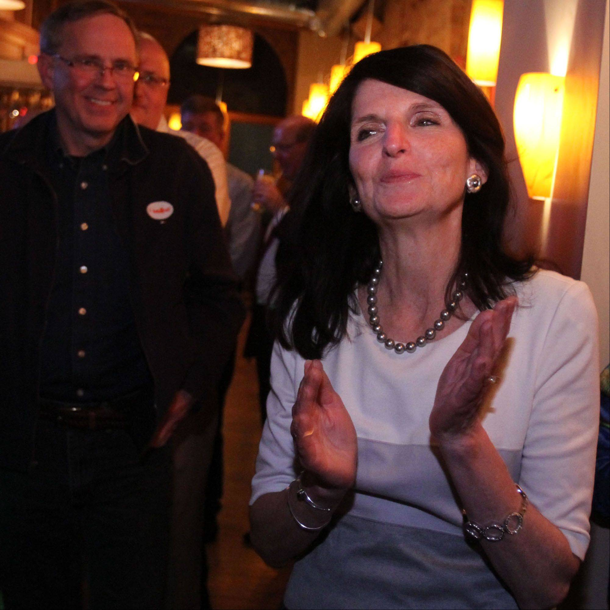 Barrington Village President Karen Darch celebrates her re-election Tuesday at McGonigal�s Pub in Barrington. Although final vote totals are pending, preliminary results show Darch cruised to victory over write-in candidate Mike Kozel.