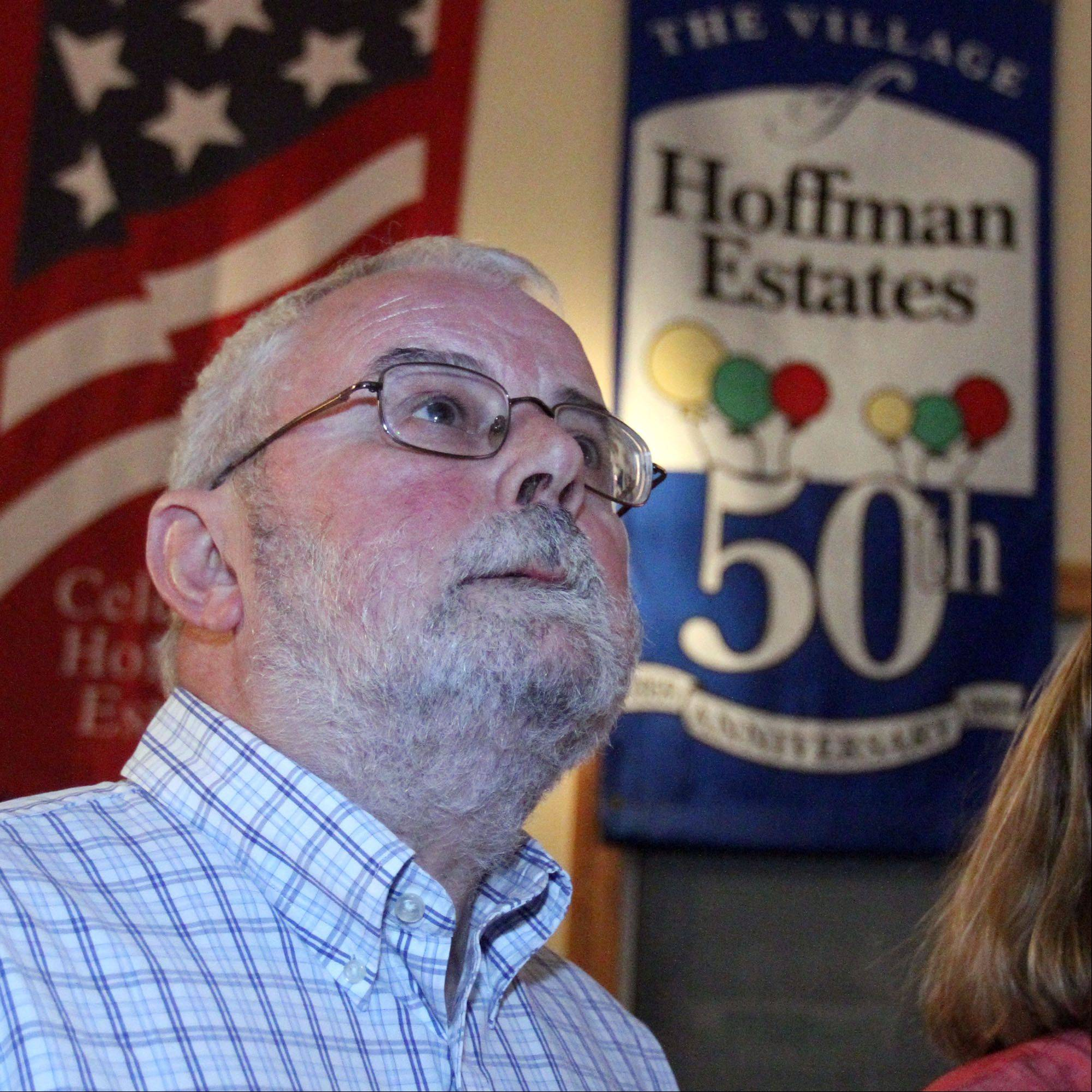 From his home, Hoffman Estates Mayor William McLeod watches election results showing him leading over challenger Ray Kincaid.