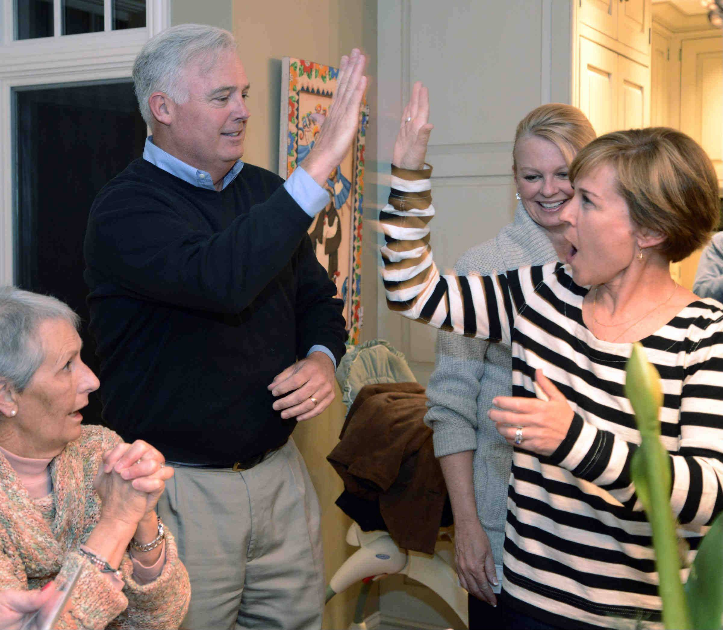 Barrington Hills Village President-elect Martin McLaughlin celebrates at his election night party with running mate Colleen Konicek Hannigan, who was elected trustee Tuesday night. McLaughlin defeated two-term Village President Robert Abboud.
