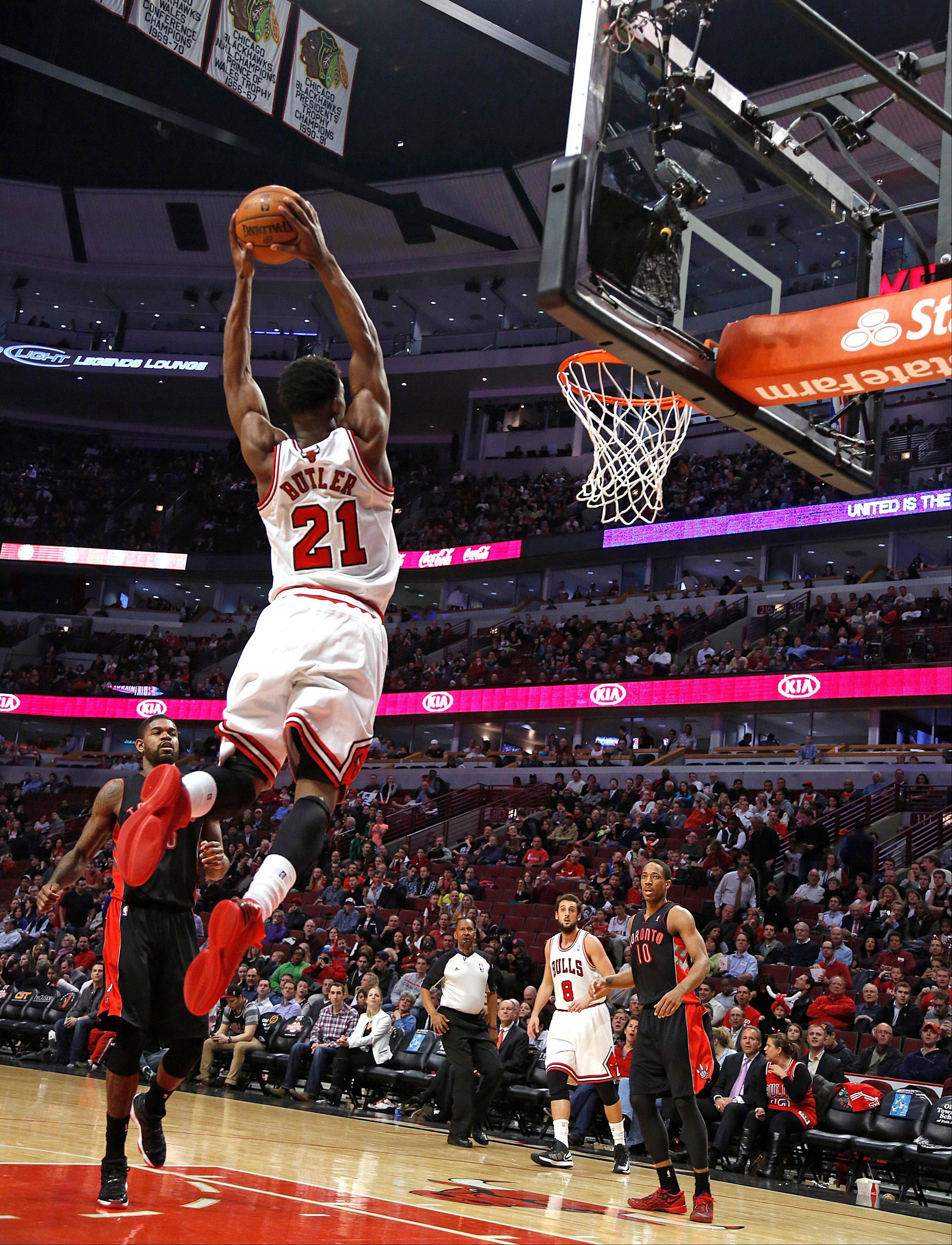 Chicago Bulls� Jimmy Butler who scored a career high 28 points is about dunk on the Toronto Raptors during the second half as the Raptors beat the Bulls 101-98 in an NBA basketball game on Tuesday, April 9, 2013 in Chicago. (AP Photo/Charles Cherney)
