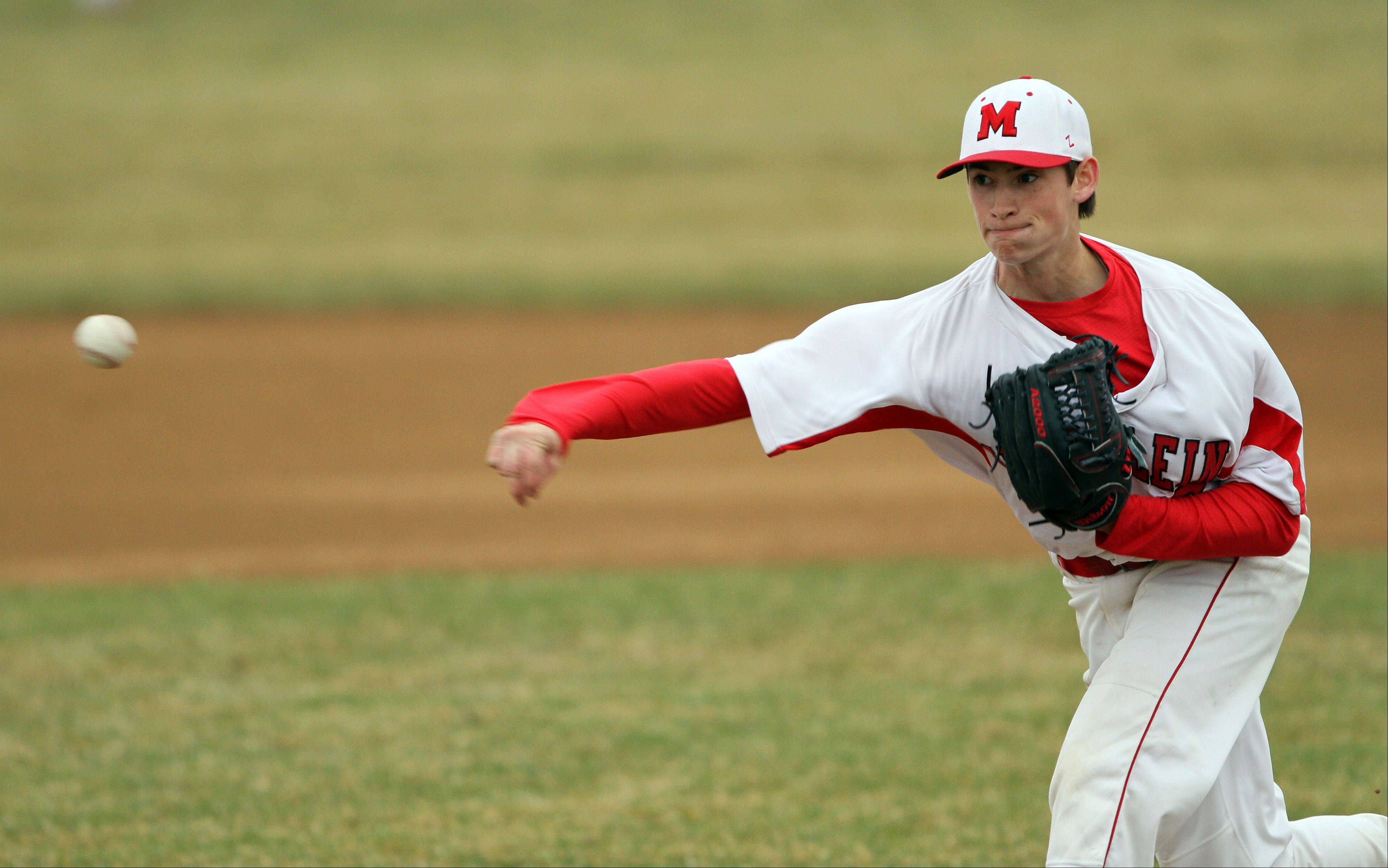 Mundelein's Mitch Schulewitz pitches to Lake Zurich on Tuesday at Mundelein High School.