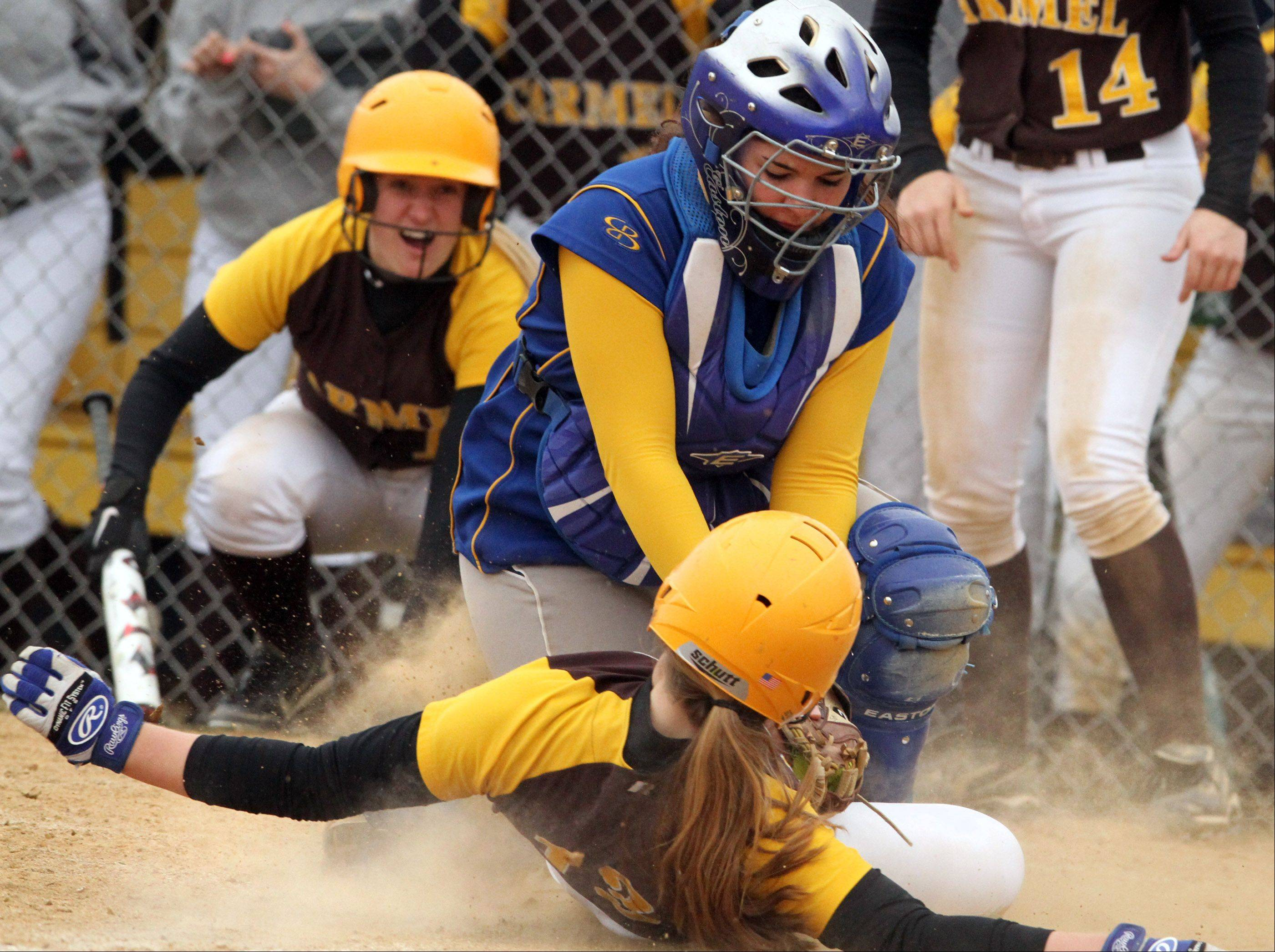 Warren catcher Sam Belletini tags Carmel�s Amanda Elert out at home during Saturday�s game in Gurnee.