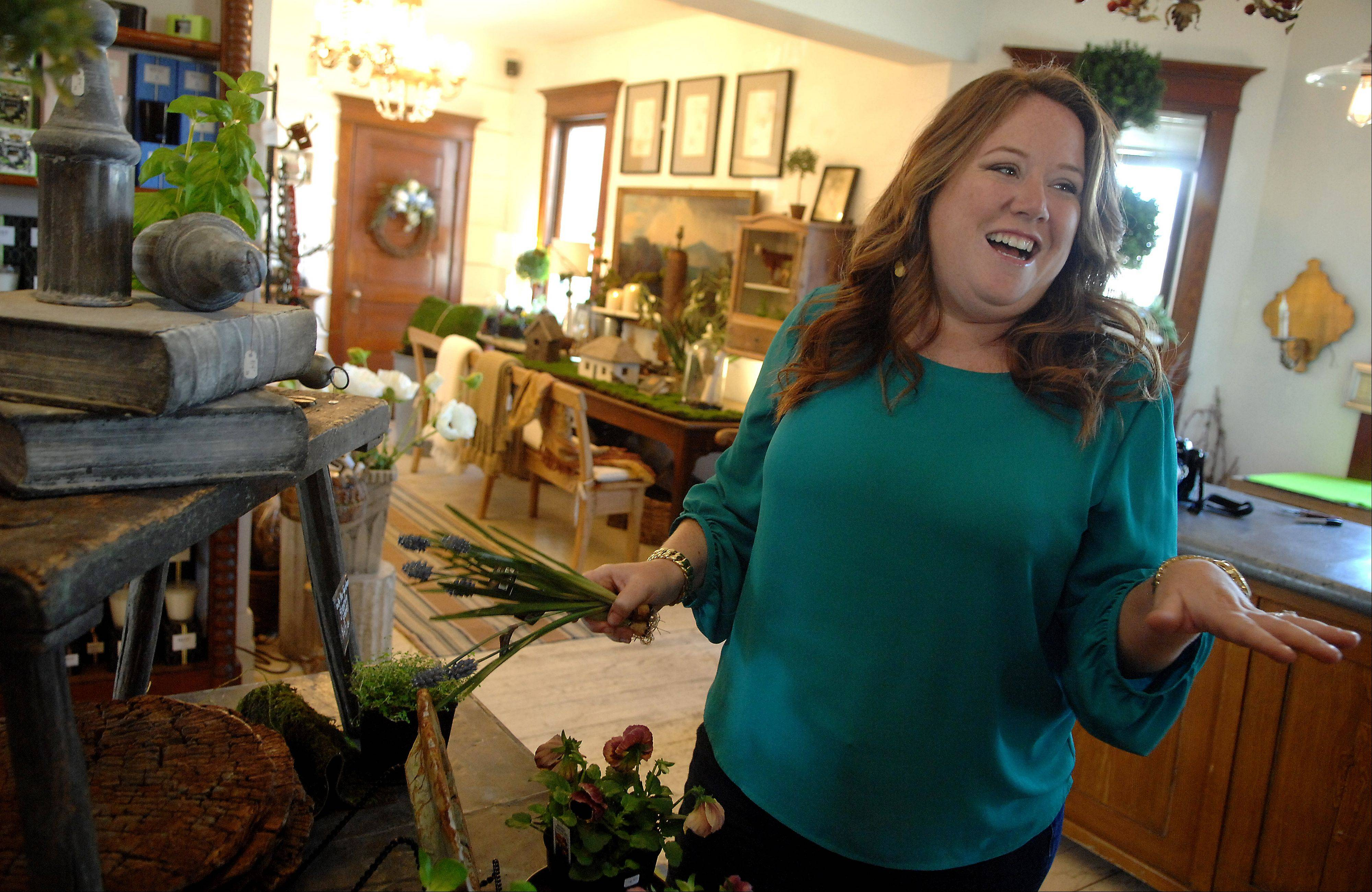 """HGTV Design Star"" winner Meg Caswell, of Kenilworth, shops for home accessories at Scentimental Gardens in Geneva."