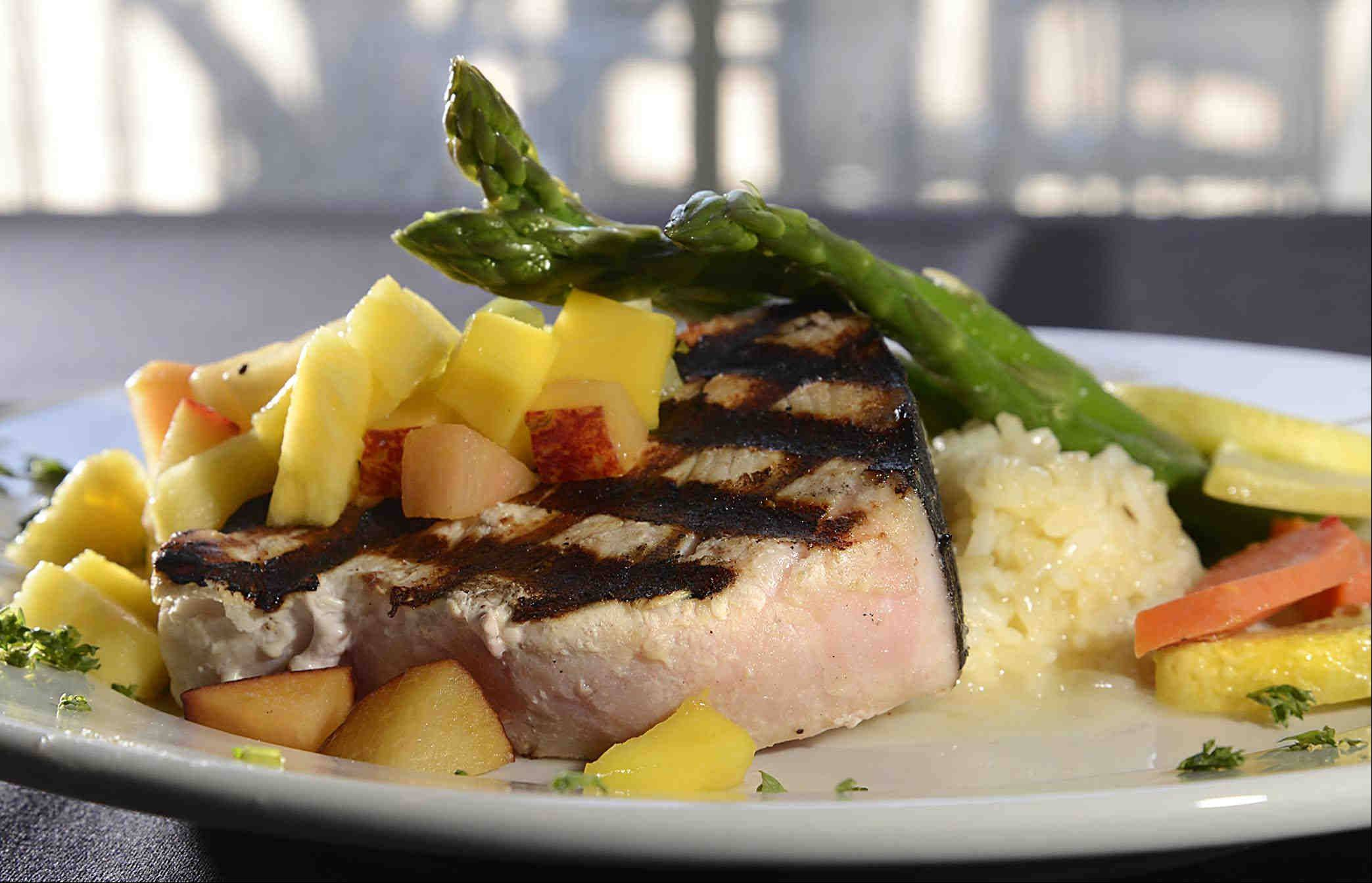 Grilled swordfish with mango, papaya, kiwi salsa and rice awaits diners at Pier 99 in Port Barrington.