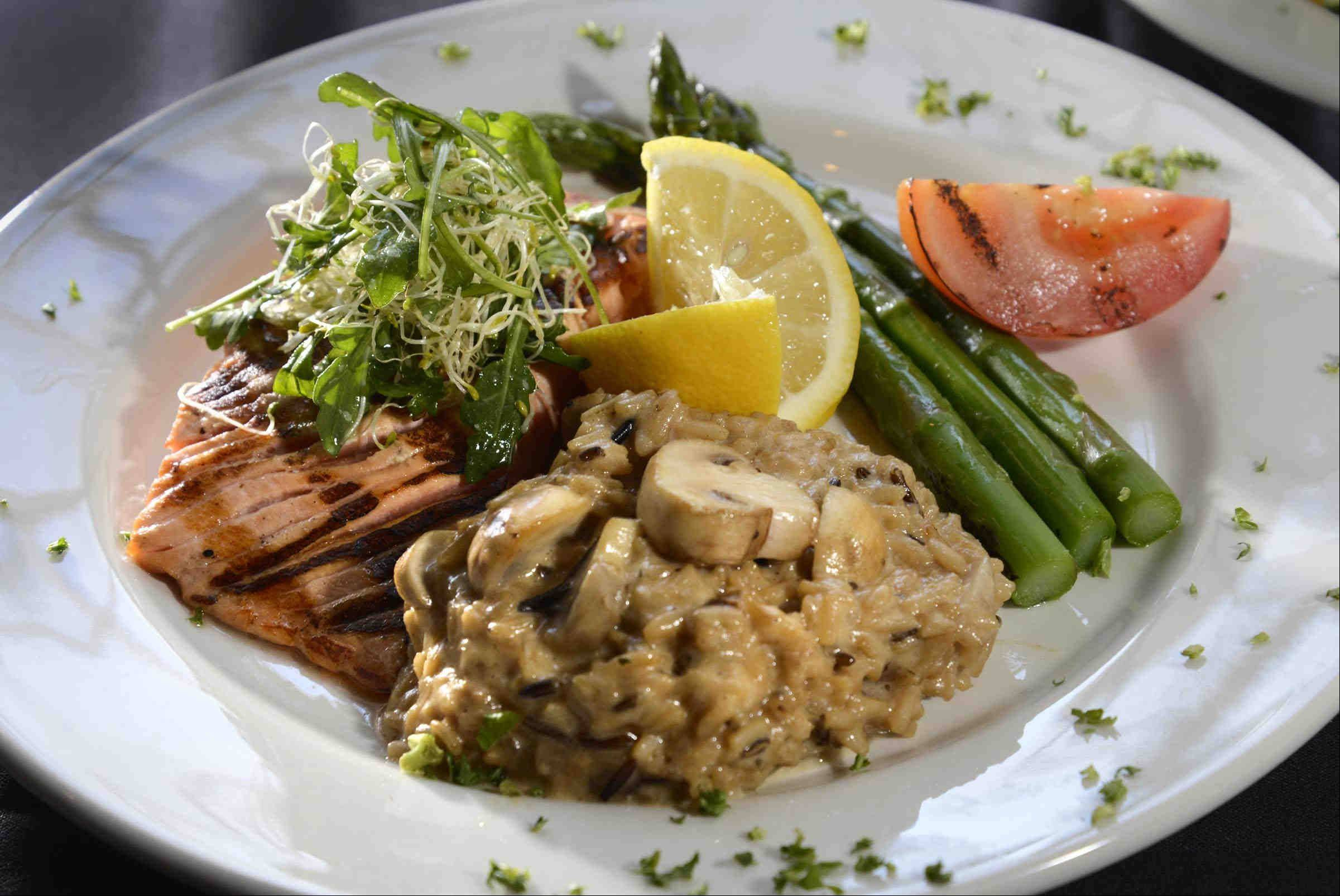 Cedar plank salmon with mushroom risotto and alfalfa arugula salad at Pier 99 in Port Barrington.