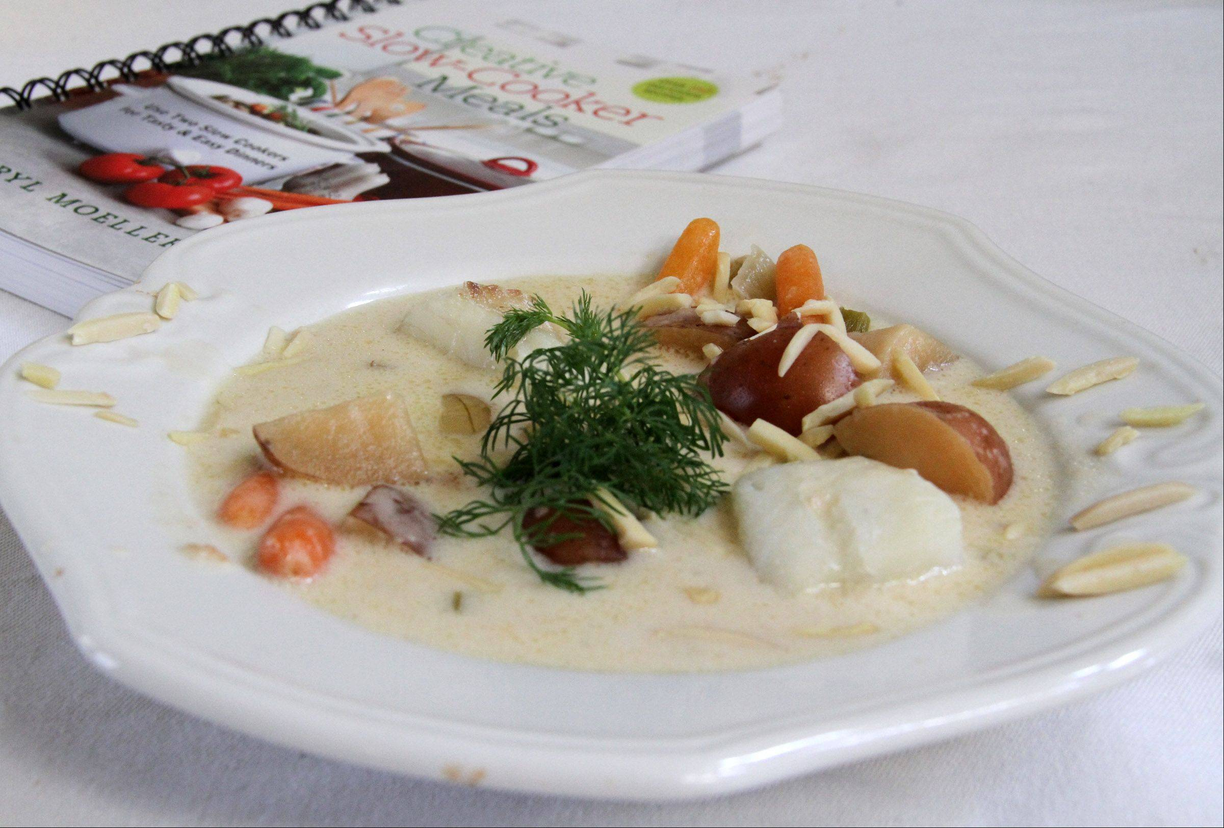 Cheryl Moeller cooks halibut chowder in a slow cooker.