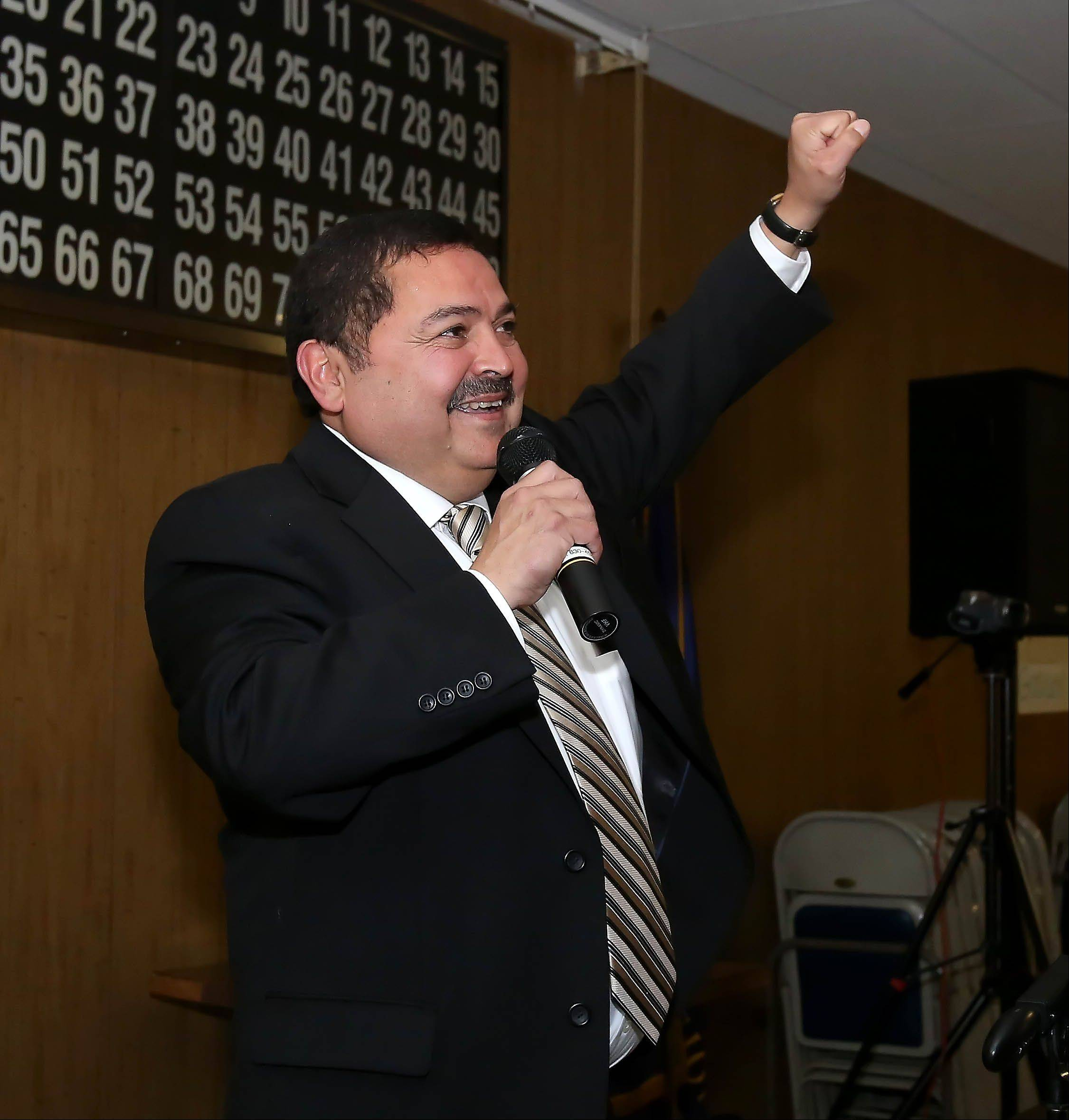 Ruben Pineda, West Chicago's first Hispanic mayor, celebrates his victory Tuesday with his supporters.