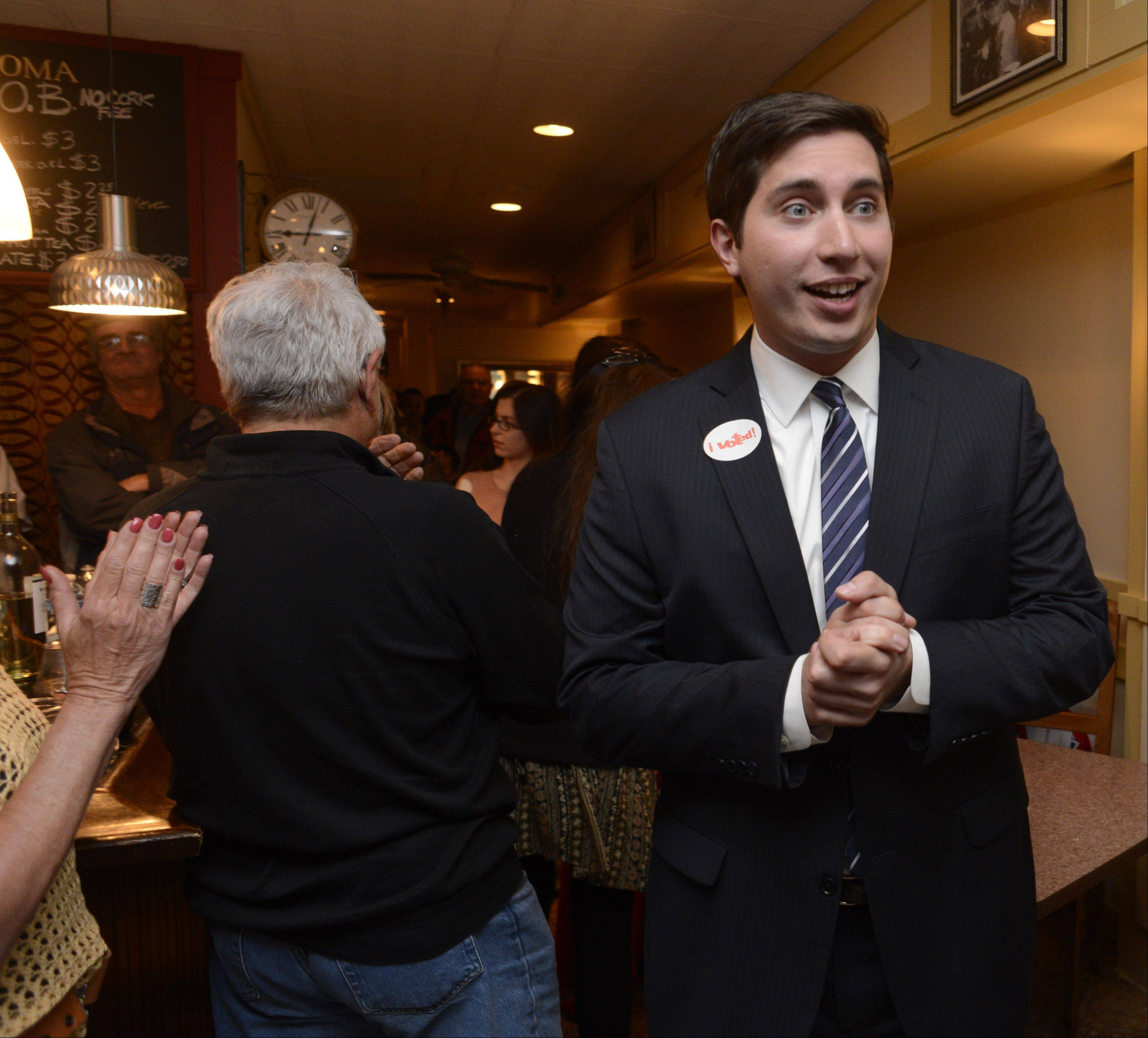 Des Plaines mayoral candidate Matthew Bogusz is greeted by supporters at Via Roma in Des Plaines on Election Night.