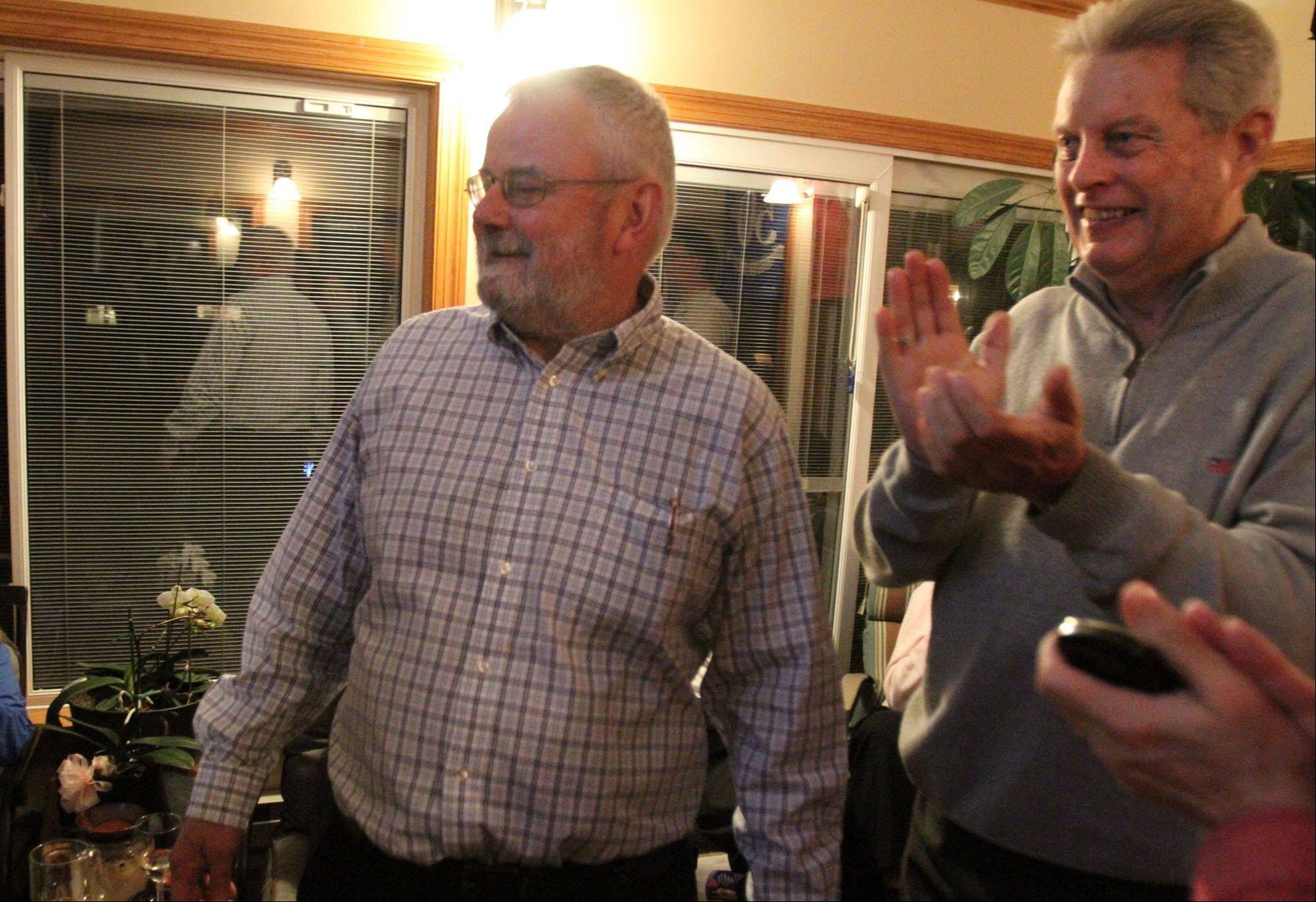 Hoffman Estates mayoral candidate Bill McLeod celebrates election results with longtime friend and former state Rep. Bob Bergman at McLeod's home in Hoffman Estates.