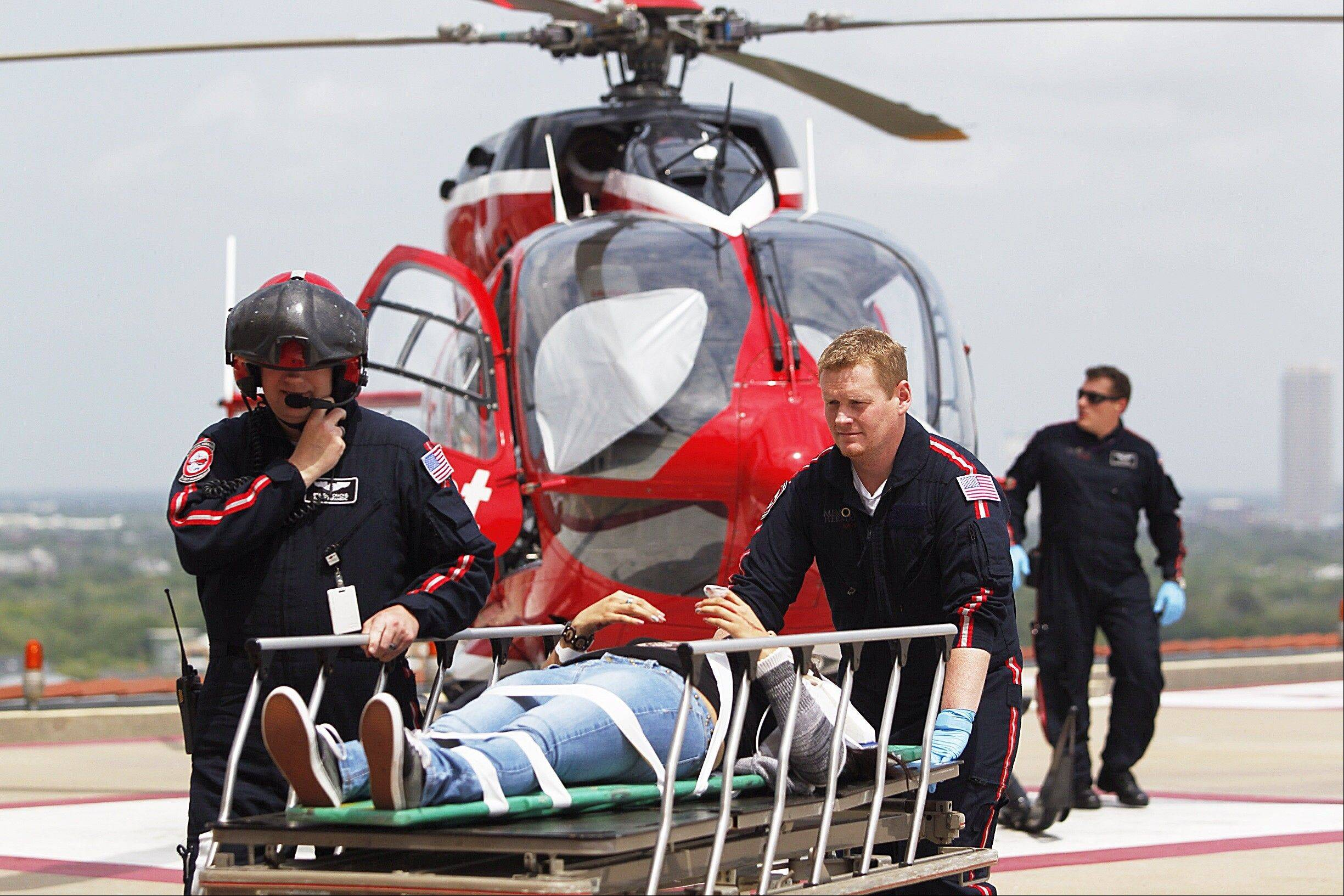 Life Flight personnel rush a victim wounded in a stabbing attack on the Lone Star community college system's Cypress, Texas campus into Memorial Hermann Hospital Tuesday.
