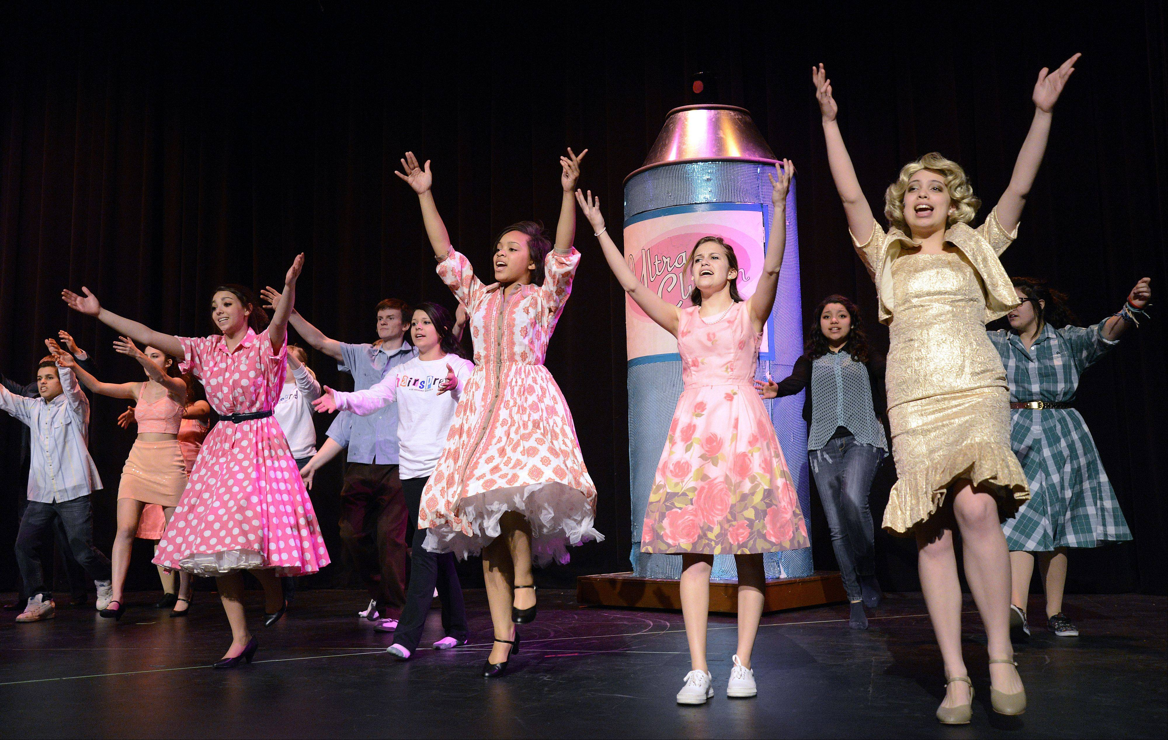 "Students rehearse the final scene in Larkin High School's production of the musical, ""Hairspray."""