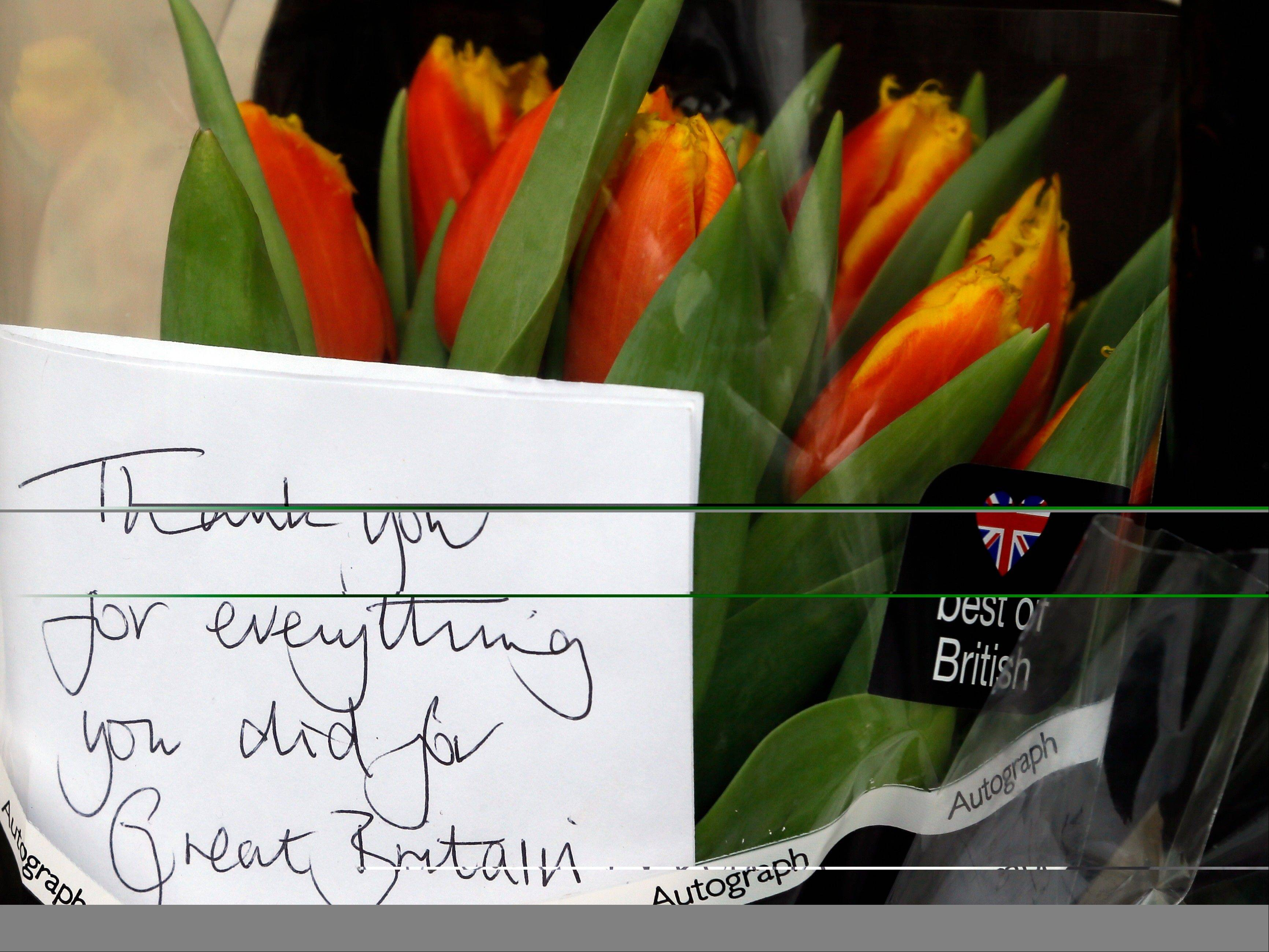 "A message written on a floral tribute left outside former British Prime Minister Margaret Thatcher's home in London, Tuesday, April, 9, 2013. Margaret Thatcher, the combative ""Iron Lady"" who infuriated European allies, died Monday. She was 87 years old."