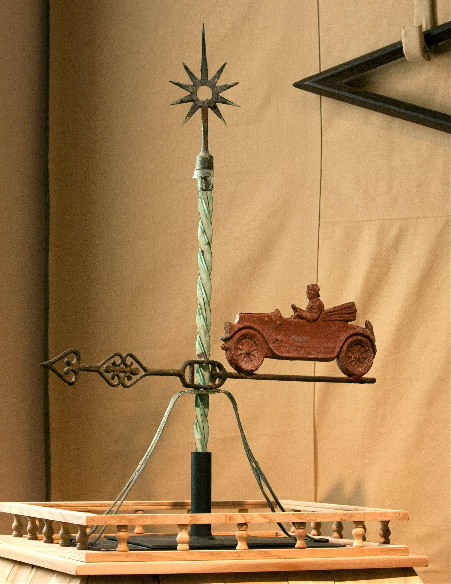 Weather vanes also served as lightning rods and became common fixtures on Midwest buildings. This one with a car might have been on top of a garage, while one shaped like a horse might have stood over a barn.