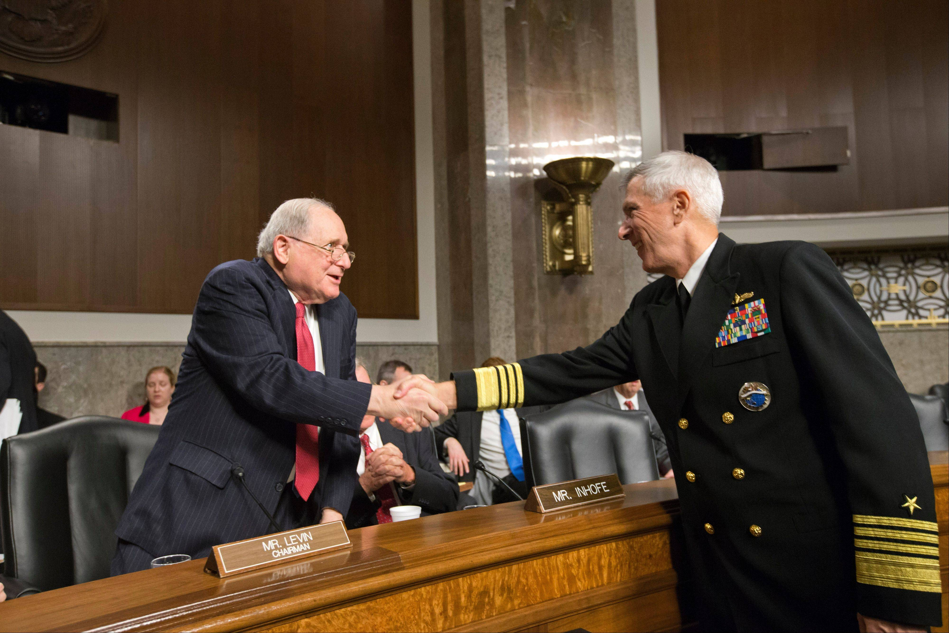 Senate Armed Services Committee Chairman Sen. Carl Levin, a Michigan Democrat, left, welcomes Adm. Samuel Locklear, commander of U.S. Pacific Command, on Capitol Hill Tuesday prior to Locklear testifying before the committee's hearing focusing on the Korean peninsula.