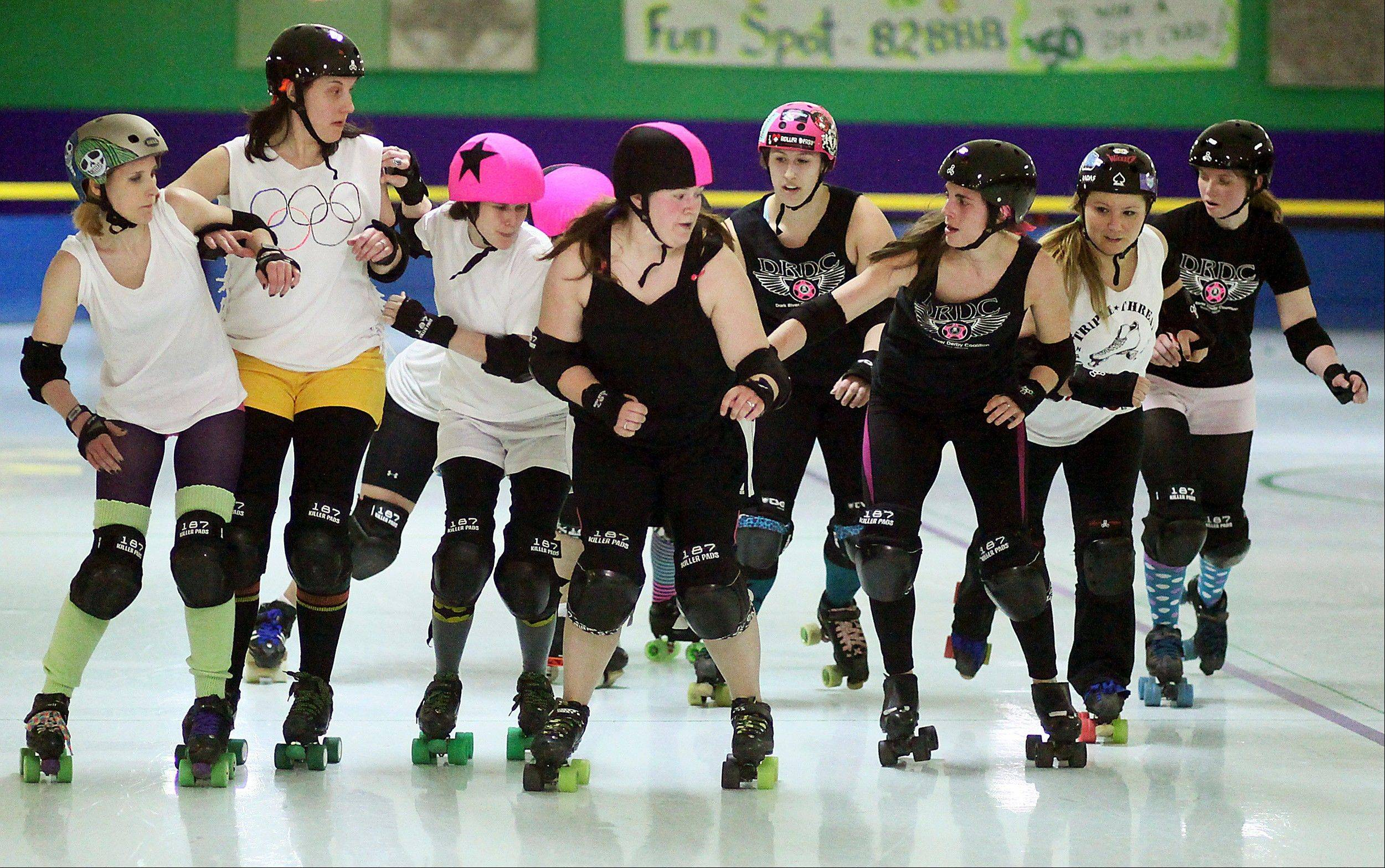 The Dark River Derby Coalition women's roller derby team, divided up into two teams, practice at Scotties Fun Spot in Quincy.