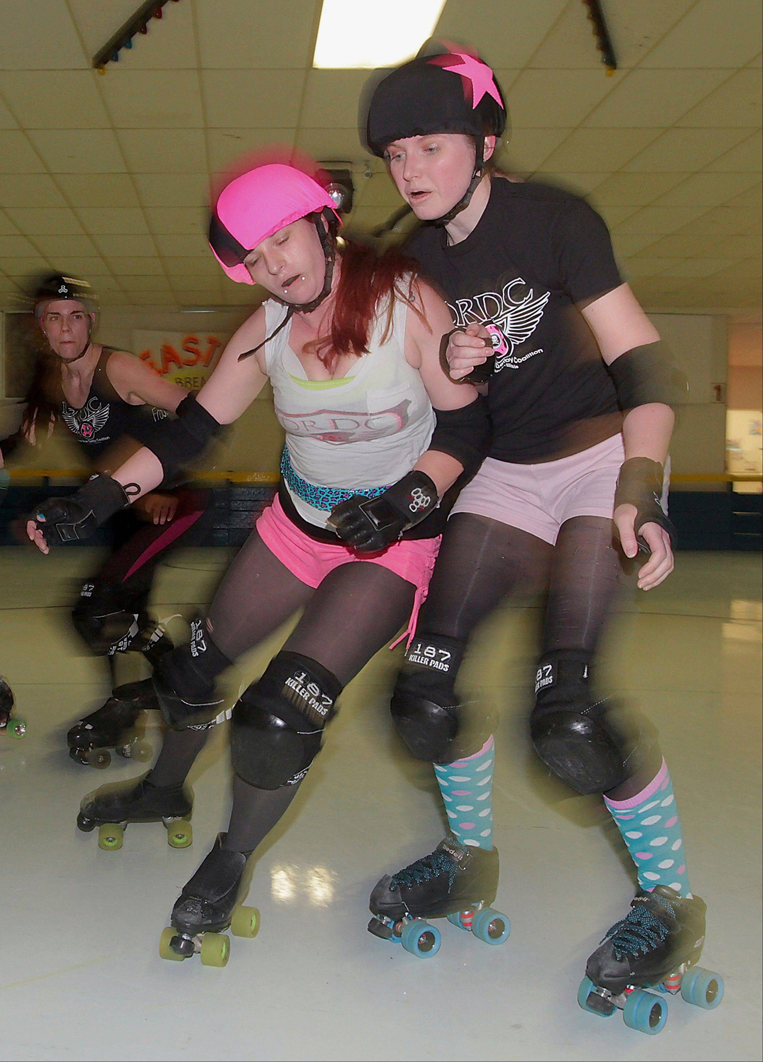 Members of the Dark River Derby Coalition women's roller derby team practice at Scotties Fun Spot in Quincy.