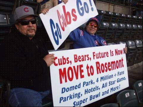 Tired of unpredictable weather, narrow walkways and ancient bathrooms at Wrigley Field, Cubs fans Rick Romanelli, right, and Ron Sershon want the Cubs to move to the suburbs.