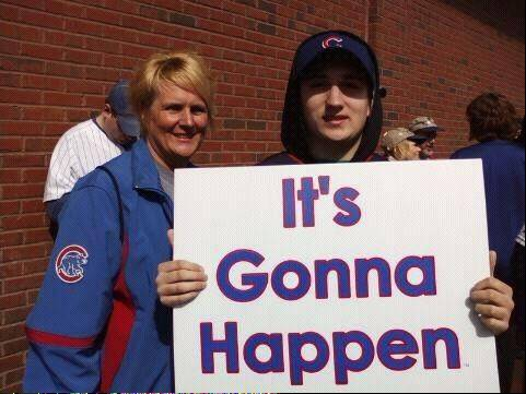 "The ""It"" in this sign might be more accurate if it refers to a giant video screen or even a move to the suburbs. But Des Plaines residents Carrie Cappa and her son, Nick, hold out hope the Cubs will win the World Series in Wrigley Field in their lifetimes."