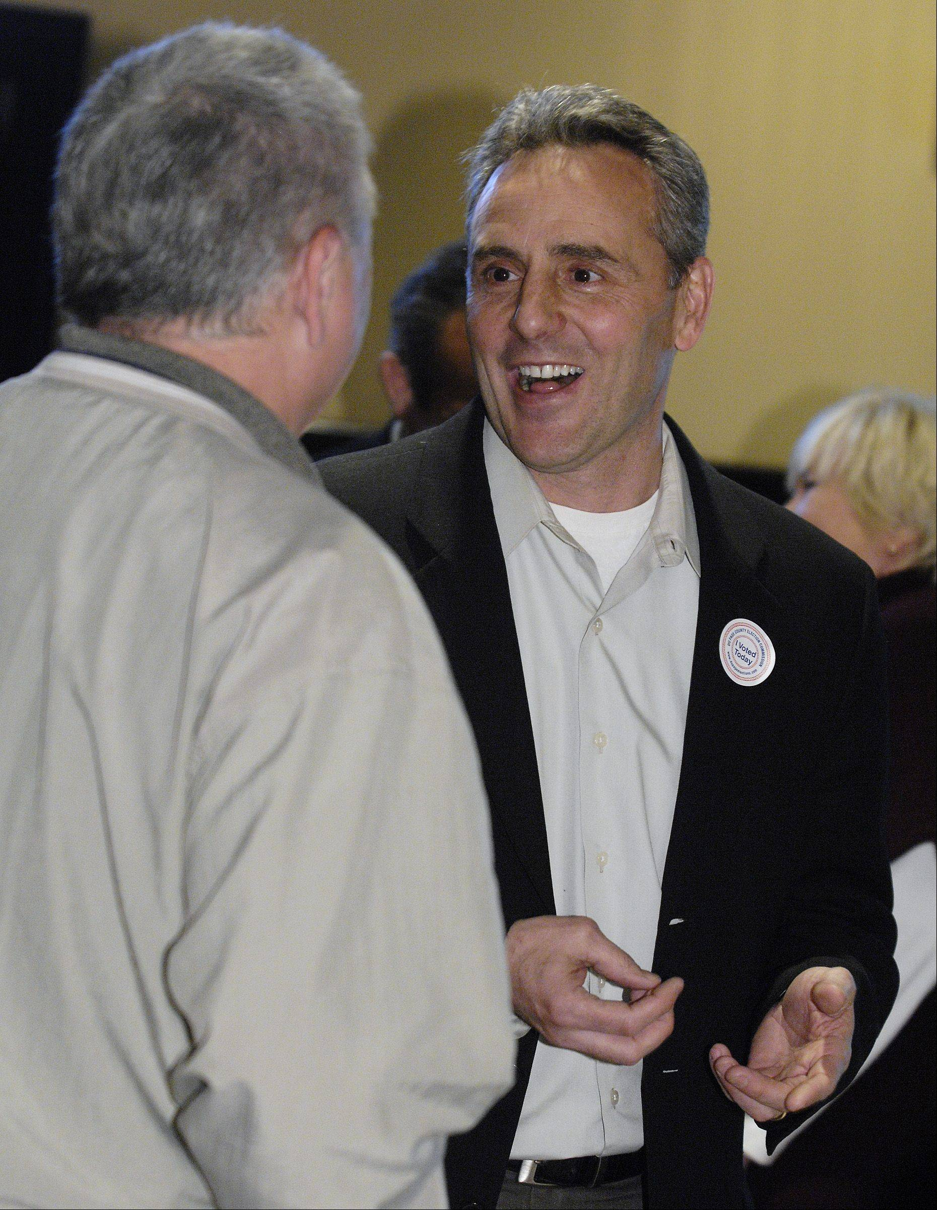 Bartlett Village President candidate Kevin Wallace talks with supporters at his election night headquarters at the Bartlett Hills Golf Club on Tuesday.