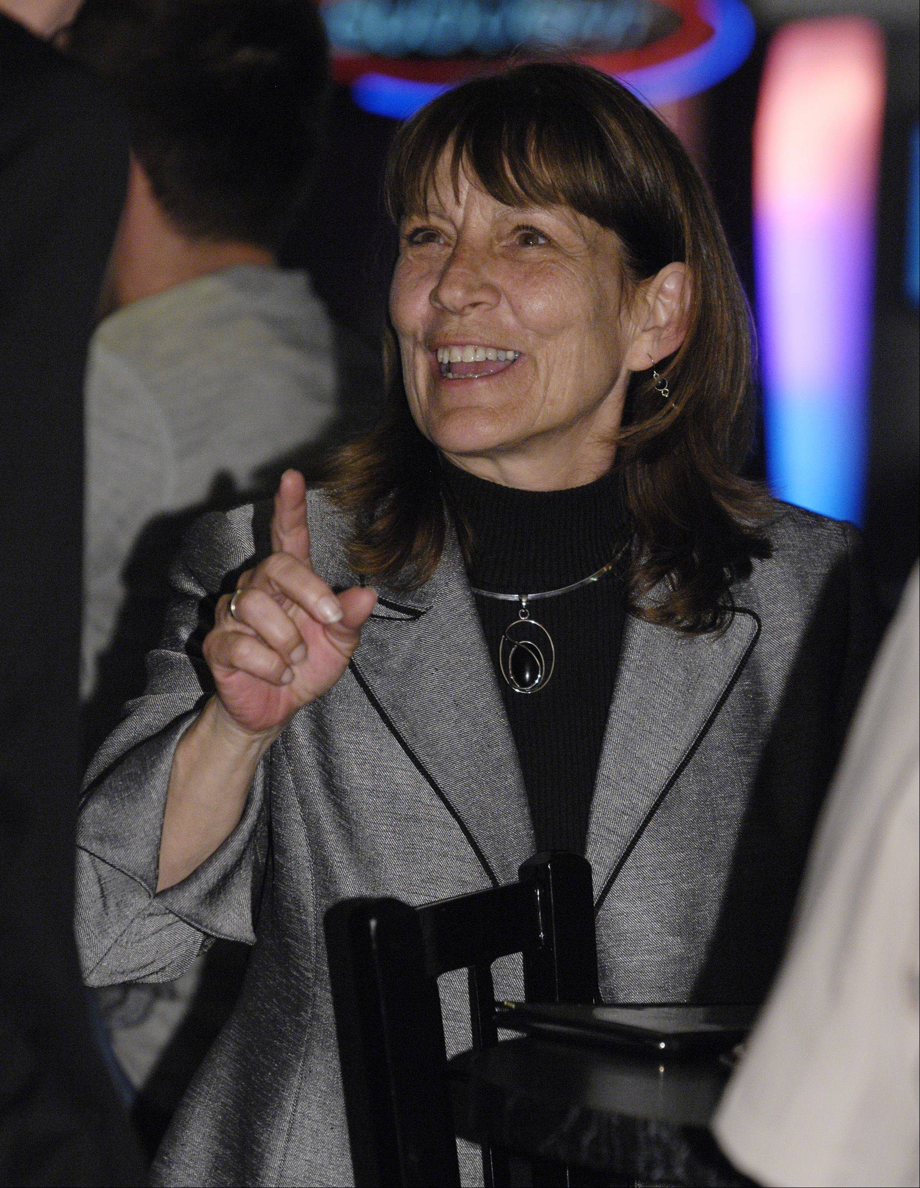 Streamwood Village President Billie Roth celebrates her victory over James Cecille at her election night headquarters Tuesday night.