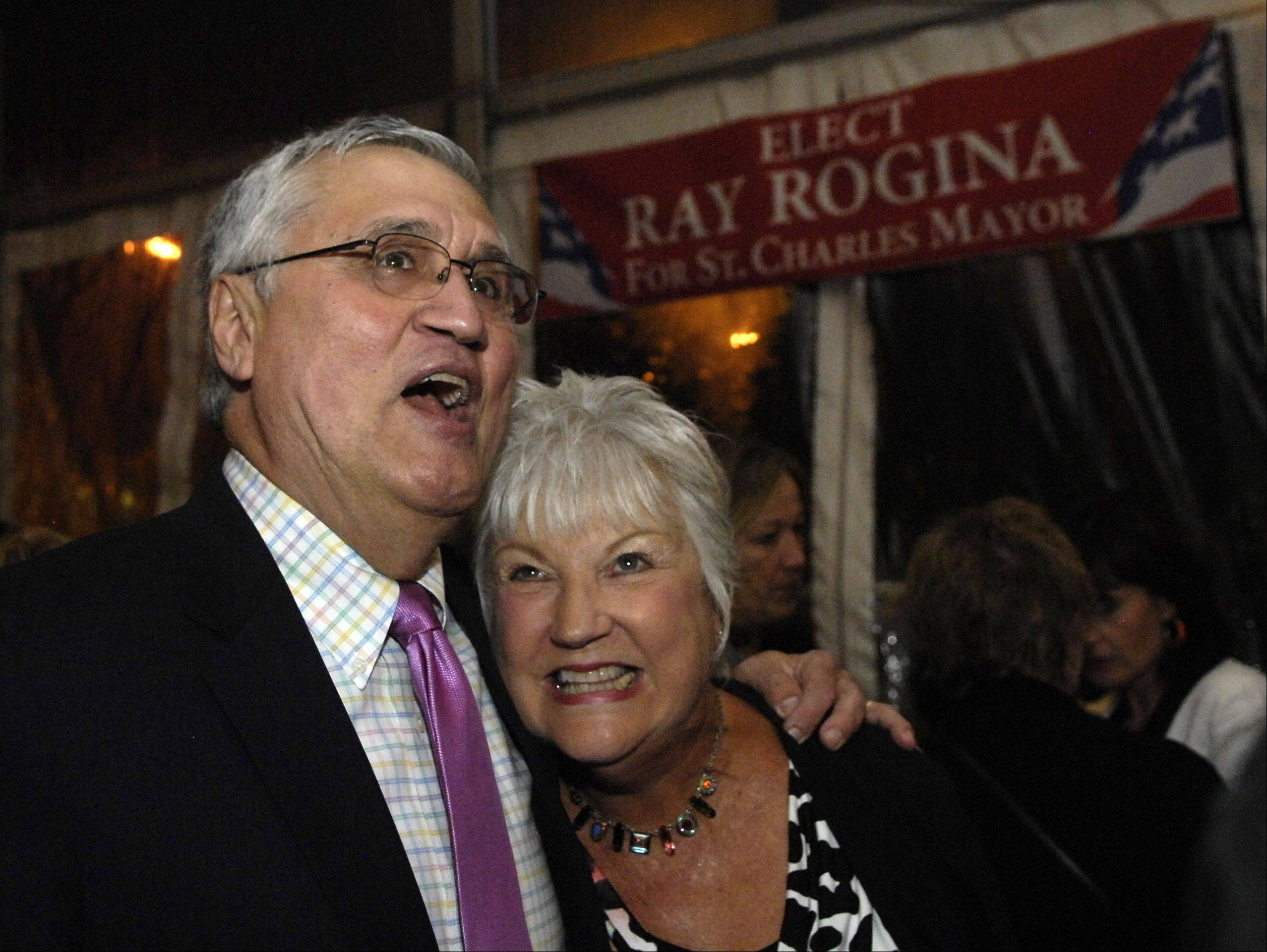 Ray Rogina gets a hug from supporter Lynn Radford of St. Charles while they check out the incoming results at The Office in St. Charles Tuesday night. Rogina was elected Mayor of St. Charles.