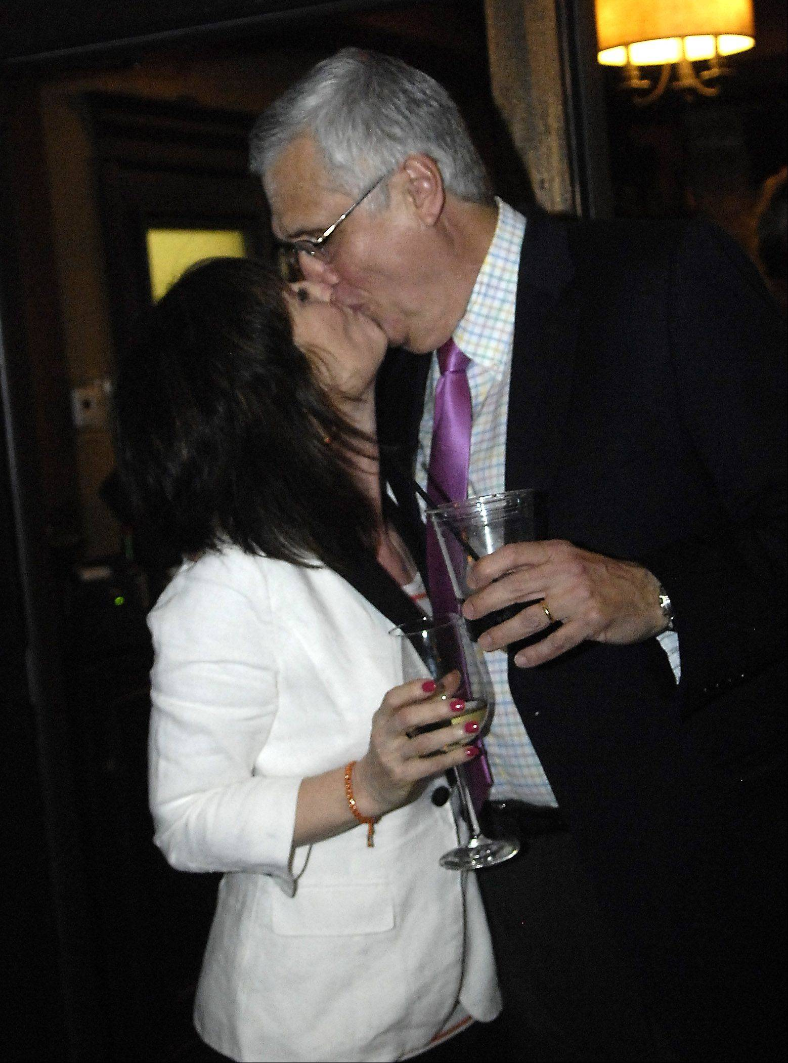 Newly elected St. Charles mayor Ray Rogina gets a kiss from his wife Diane Cullen when the news becomes official that he won during his election night party at The Office in St. Charles Tuesday.