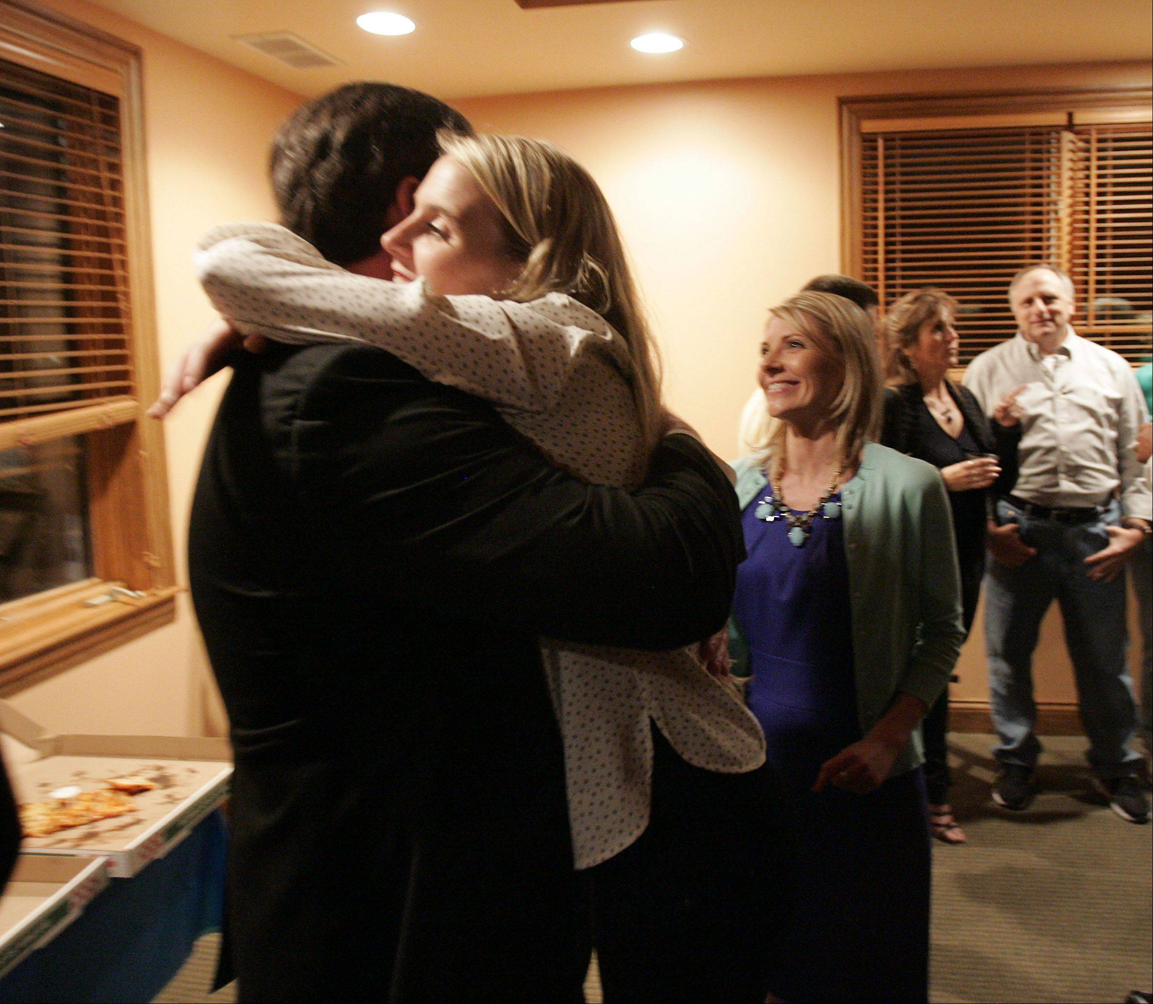 Geneva mayor Kevin Burns gets a big hug from his daughter Grace Burns after the mayoral race was called in his favor.