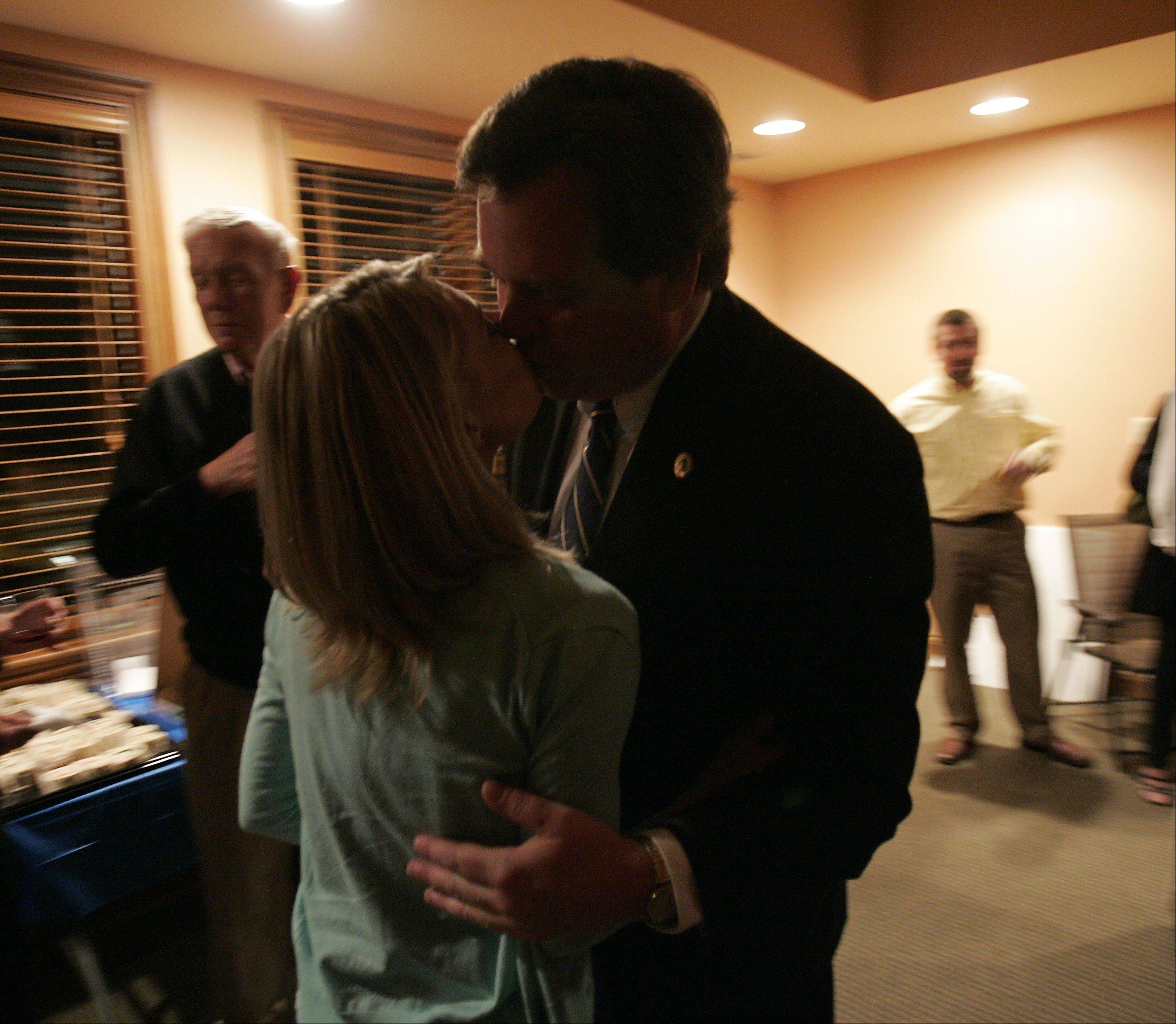 Geneva mayor Kevin Burns collects a kiss from his girlfriend Aimee Bychowski after results in his re-election bid rolled in Tuesday.