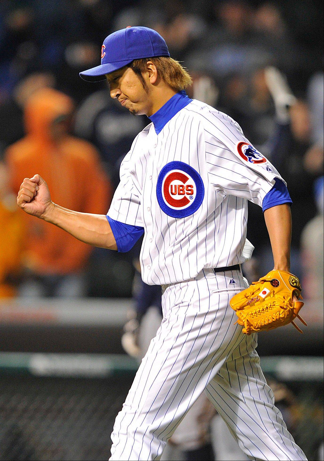 Kyuji Fujikawa reacts after saving the Cubs' 6-3 victory over Milwaukee on Tuesday at Wrigley Field.